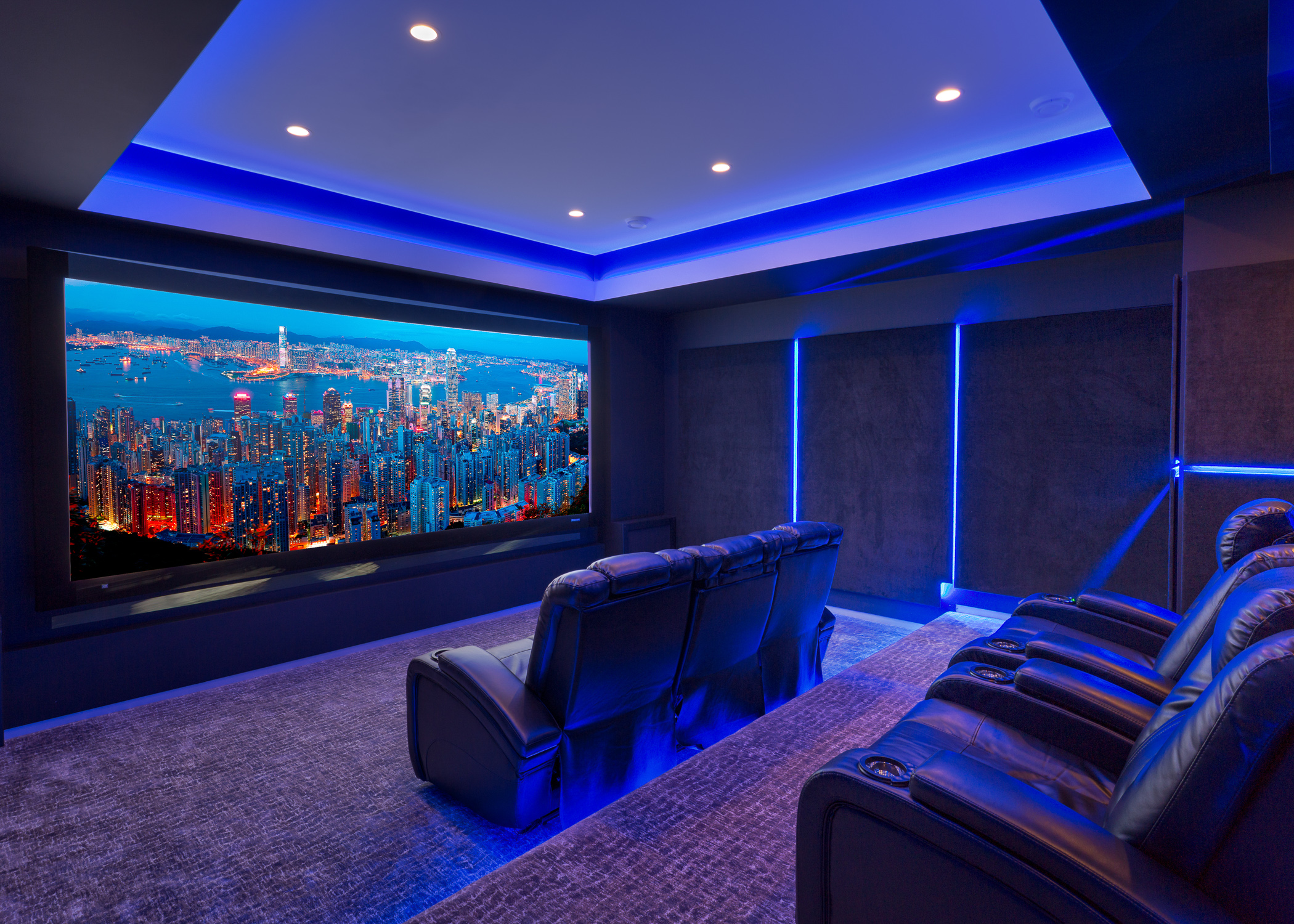 Executive home private theatre room highlighted with blue lighting