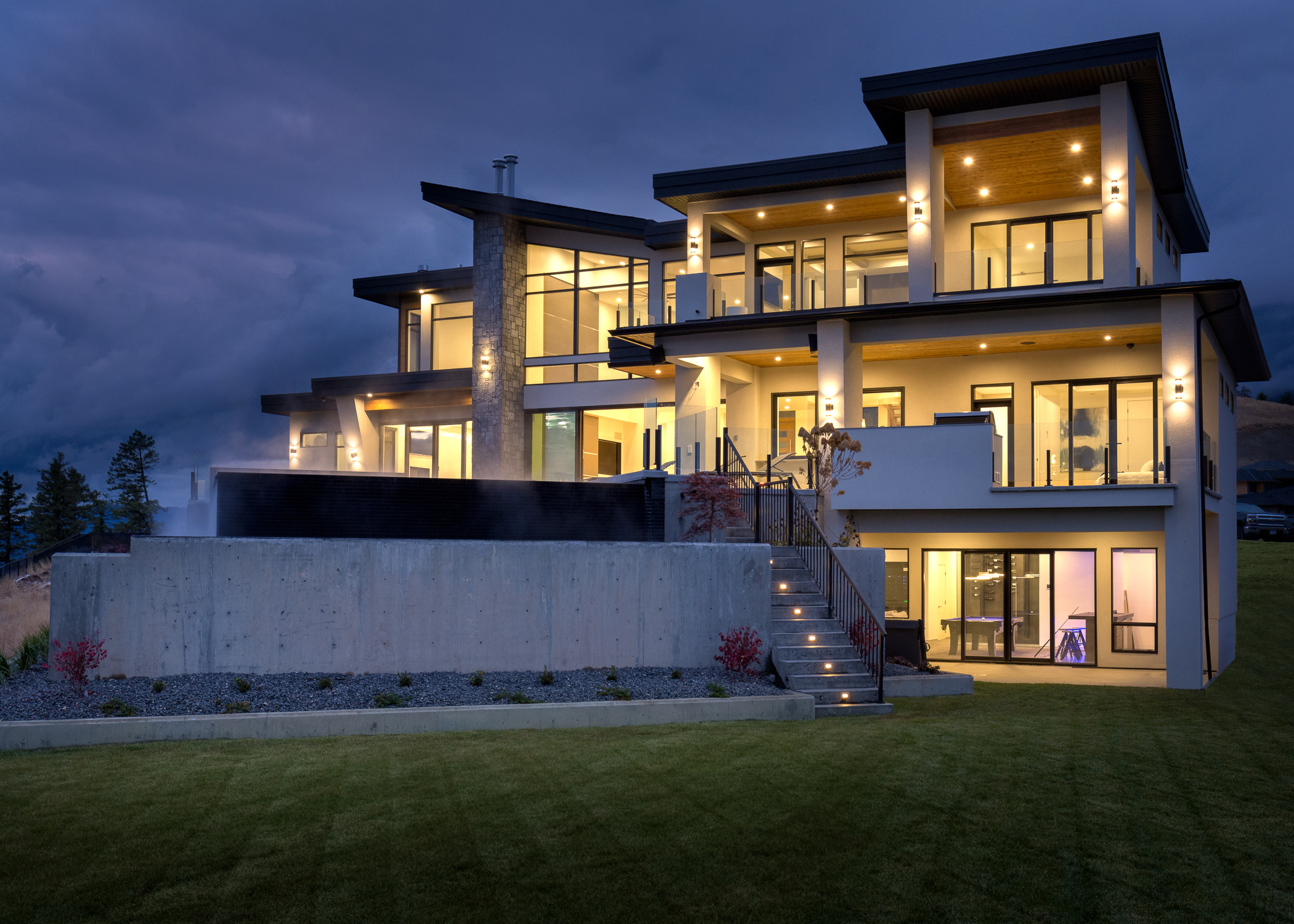 Executive home lit up at night