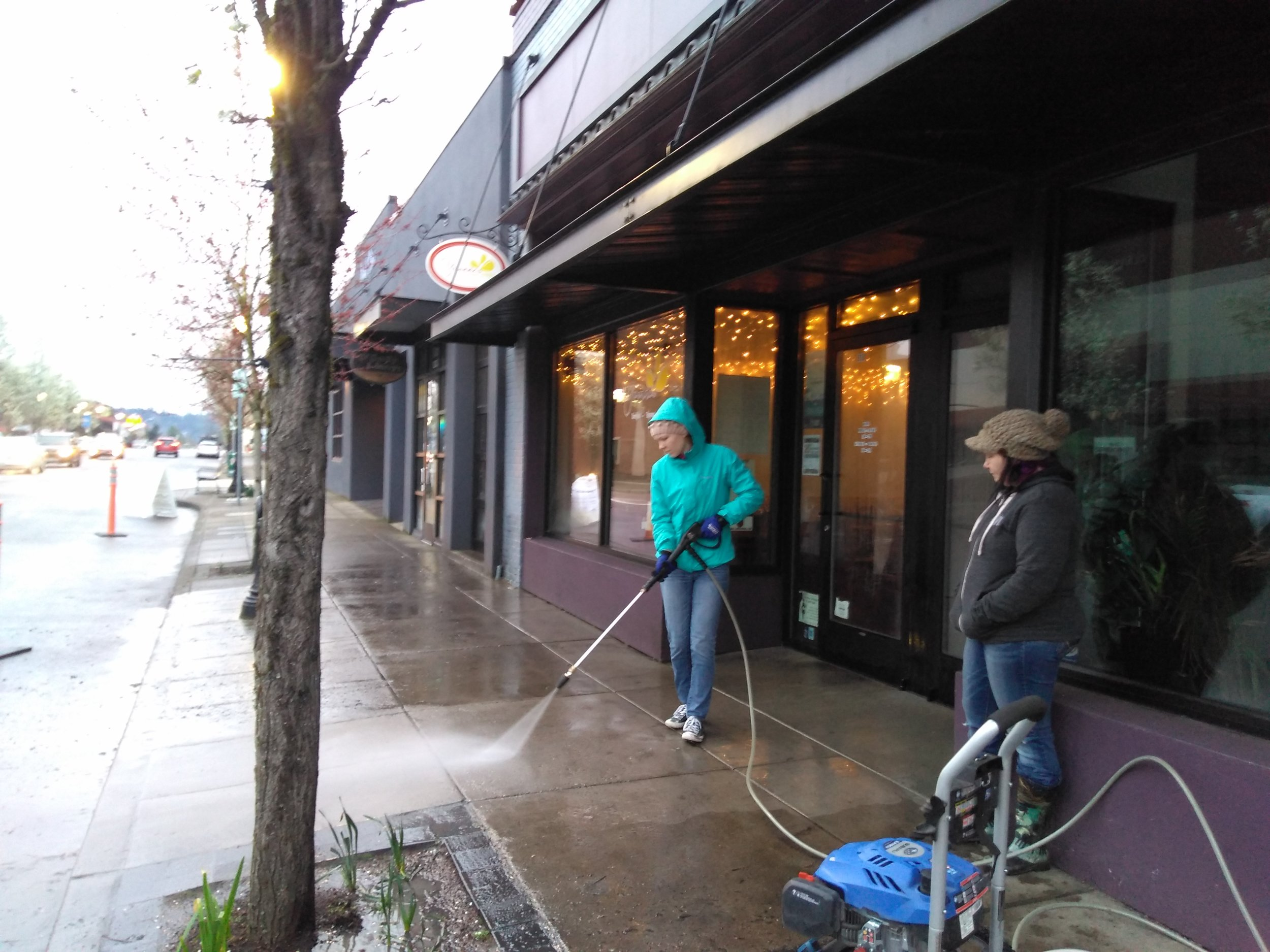 Jane and Liberty fire up the power washers on Main Street