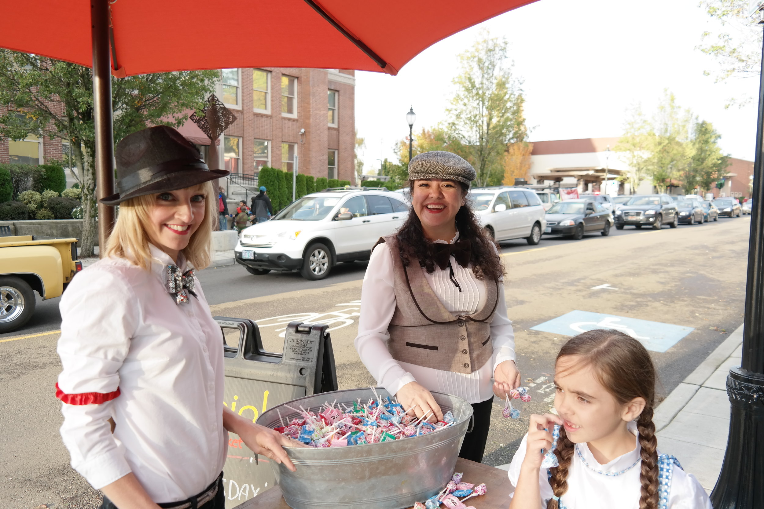Nebbiolo hands out candy at Trick or Treat on Main Street.