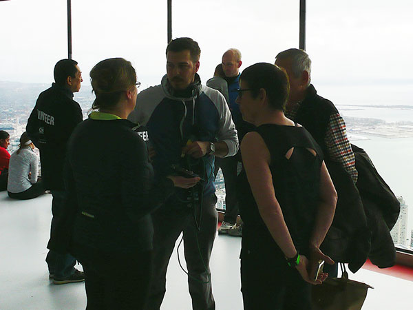 Chatting with Tamara (left), Fatima (bottom right) and Nick (top right) at the top of the CN Tower following Fatima's climb.