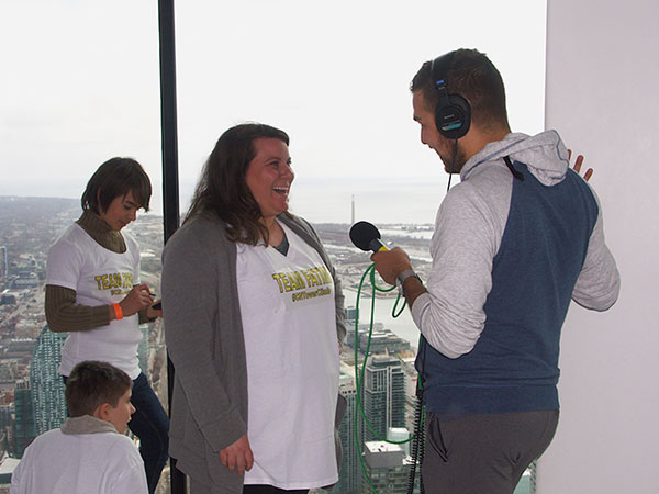 Interviewing Fatima's youngest daughter, Alexandra Hrienko-Chilcott, at the top of the CN Tower following Fatima's climb.