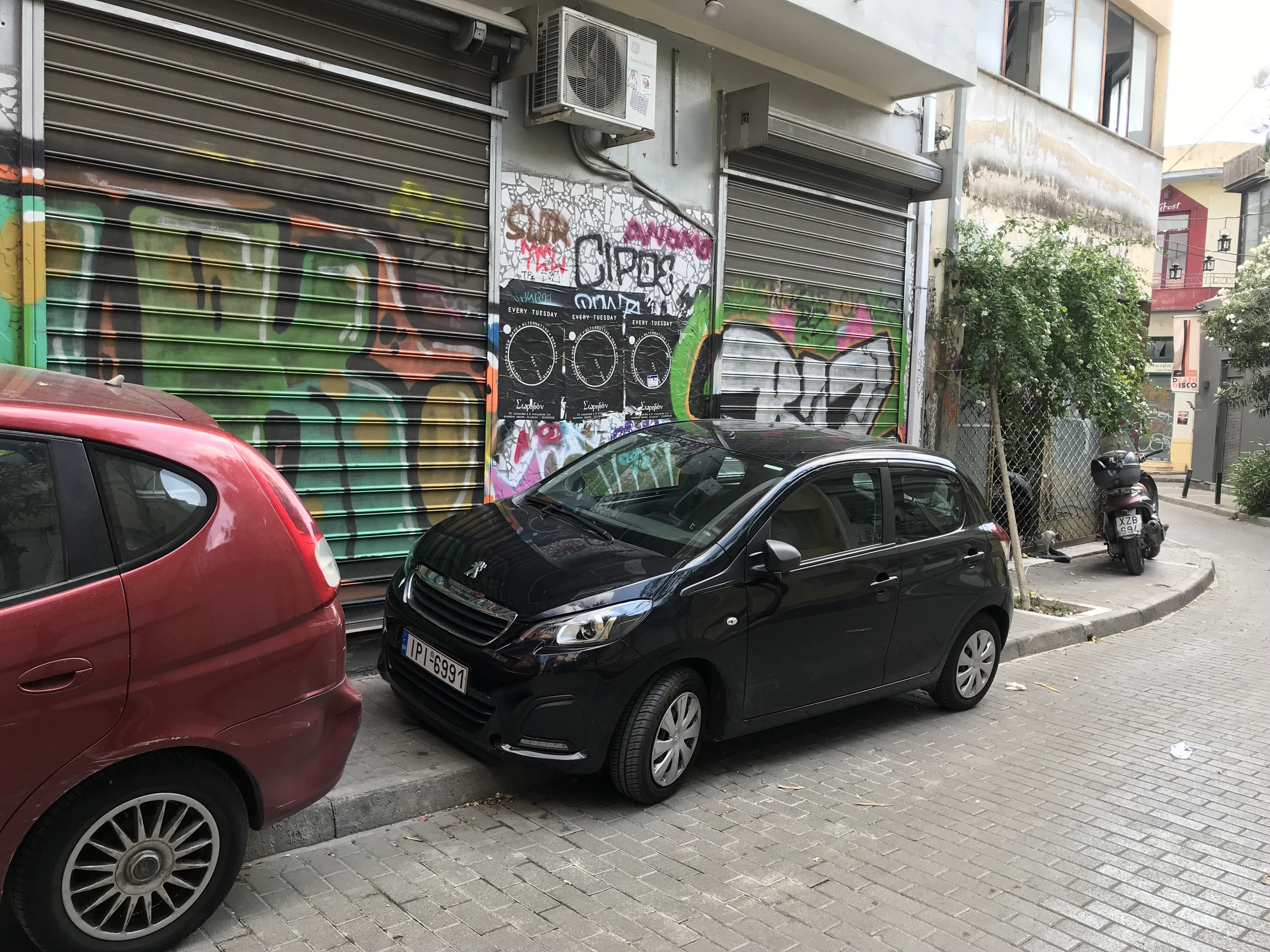 Our car parked in a tight spot, Athens.