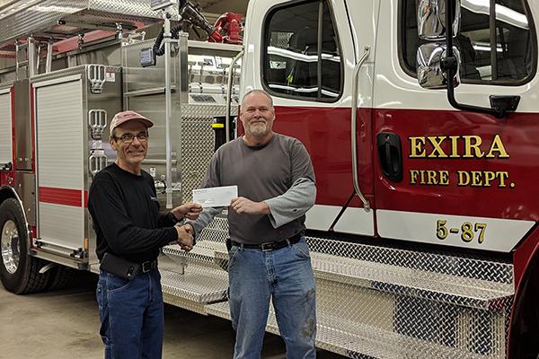 METC's Jim Lindgren presenting to Tim Wahlert representing Exira Fire & Rescue