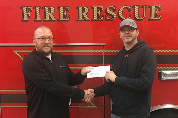 METC's Terry McCarthy presenting to Jeremy Vanarsdol representing the Neola Fire Department.