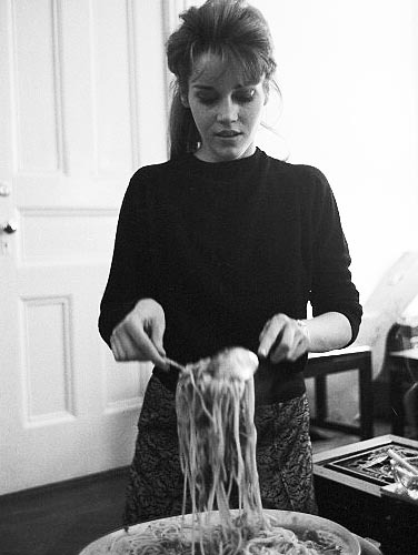 Jane Fonda cooking at home in her New York apartment, 1960