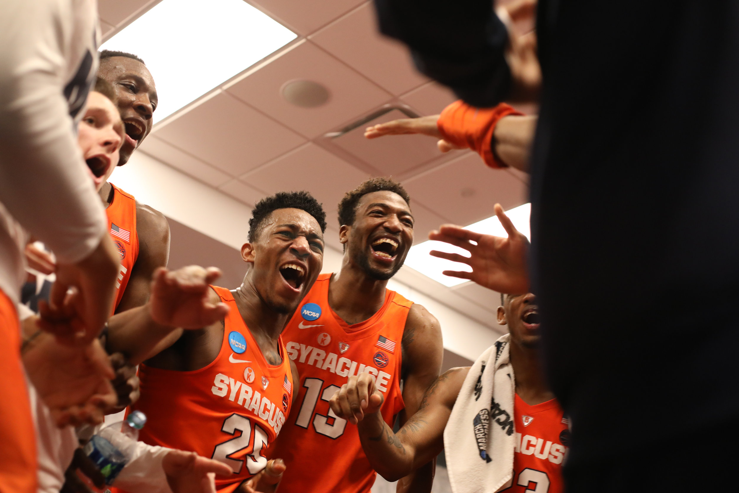 Syracuse men's basketball team celebrate after their win against Michigan State in the second round of the NCAA Tournament on March 18, 2018.
