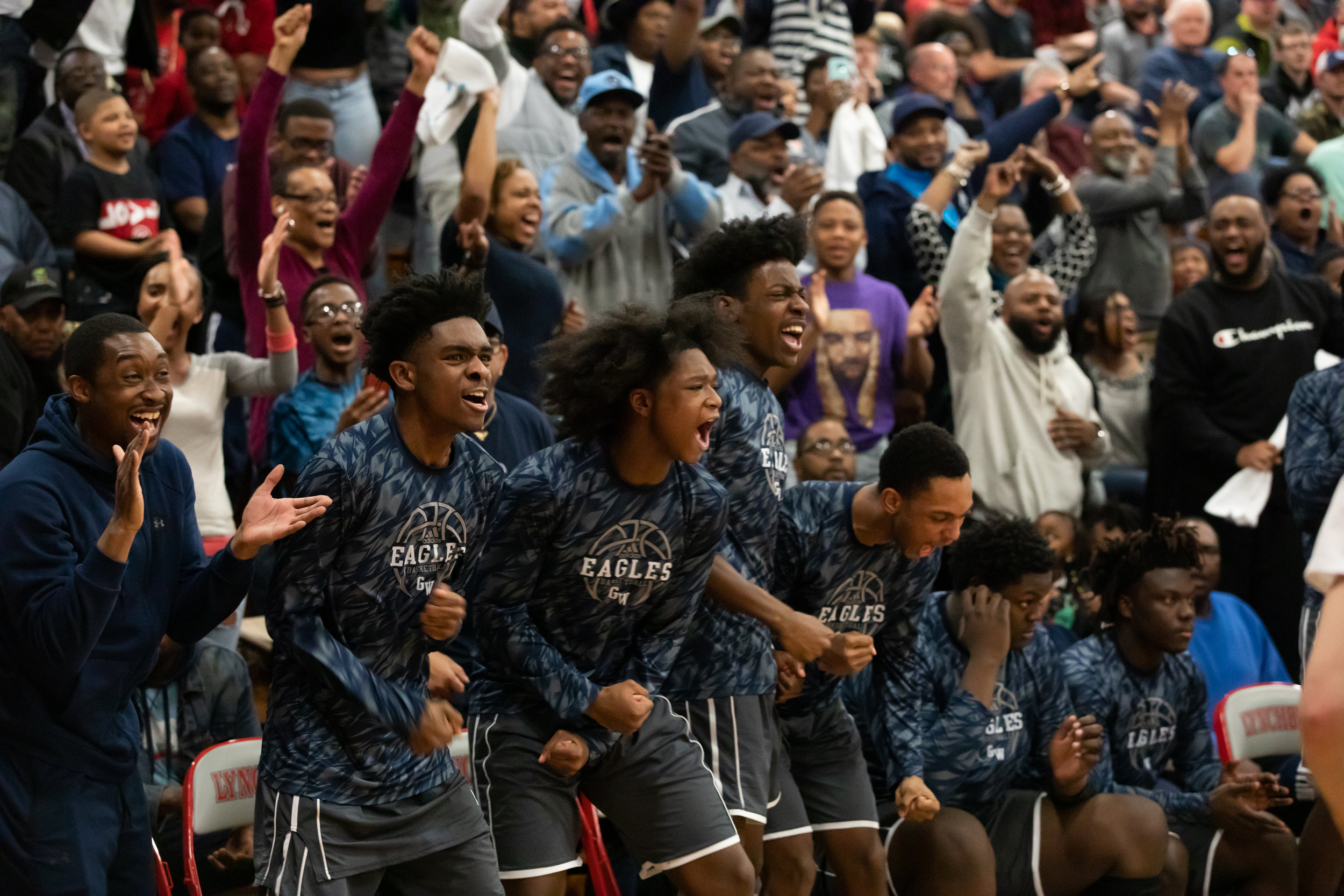 George Washington High School basketball team cheers from the sidelines during the state semi-final game between Jefferson Forest High School and George Washington High School on March 5, 2019 at University of Lynchburg's Turner Gymnasium.