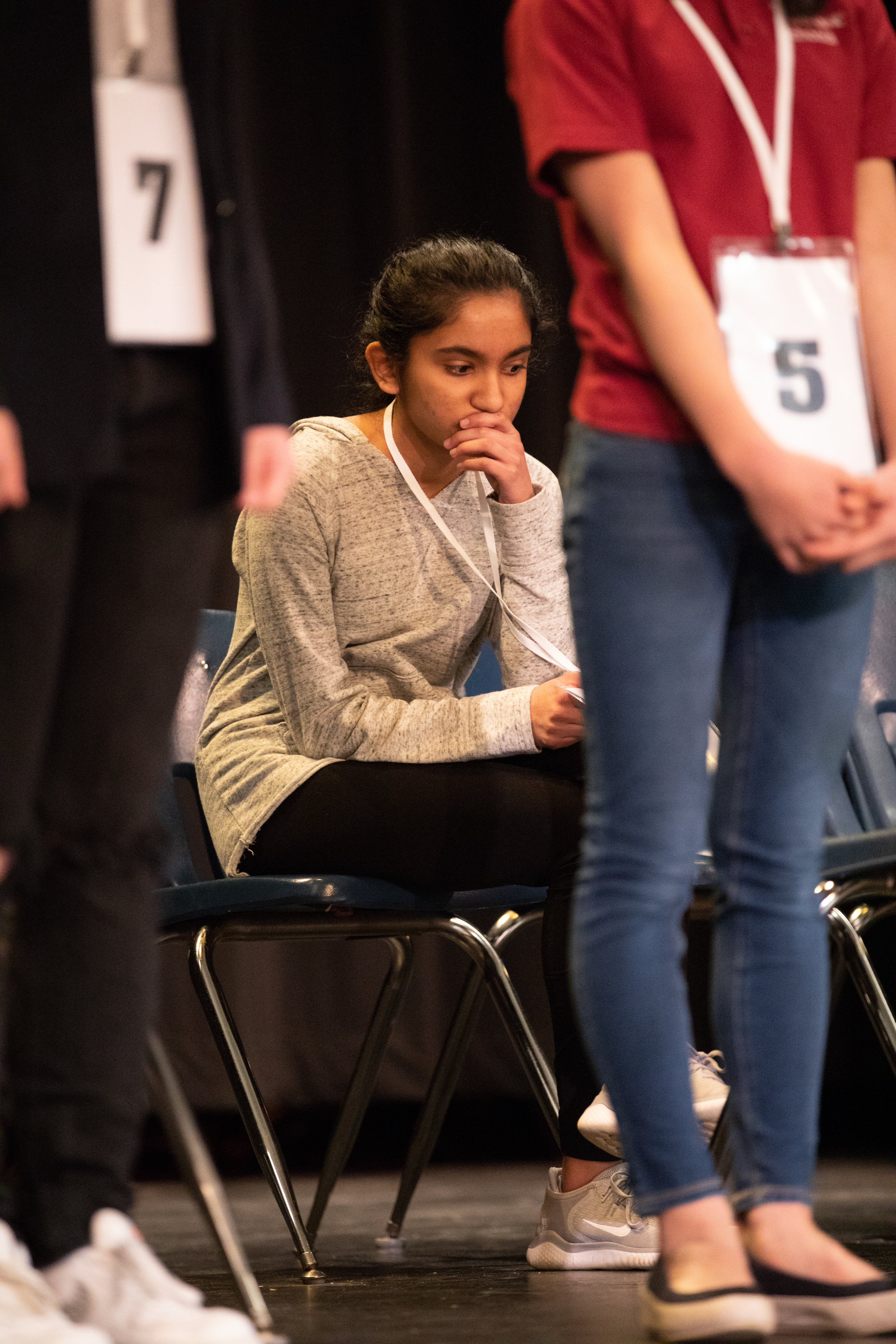 Nikitha Prabhu of James River Day School waits anxiously for her turn during one of the last rounds of the Lynchburg Regional Spelling Bee on March 9, 2019 at Dunbar Middle School for Innovation.