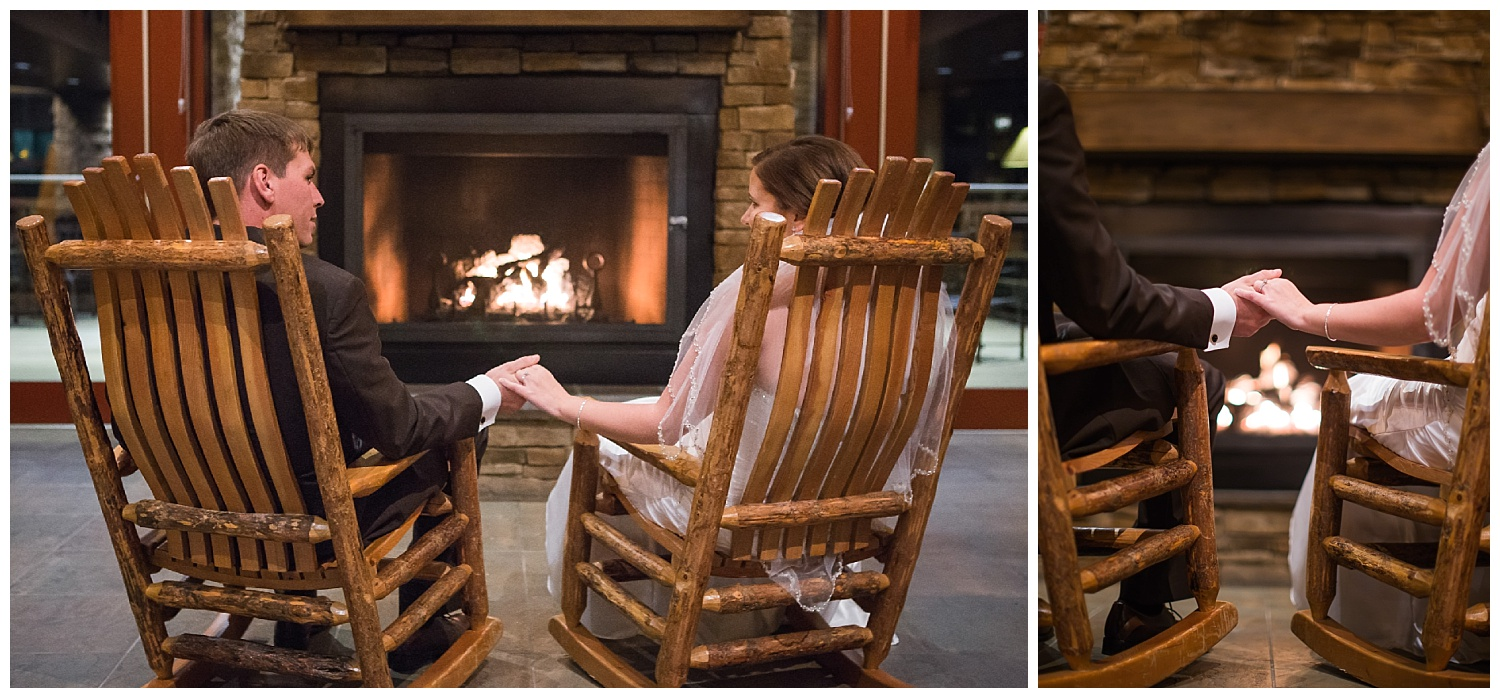 bride and groom sit on rocking chairs by fireplace