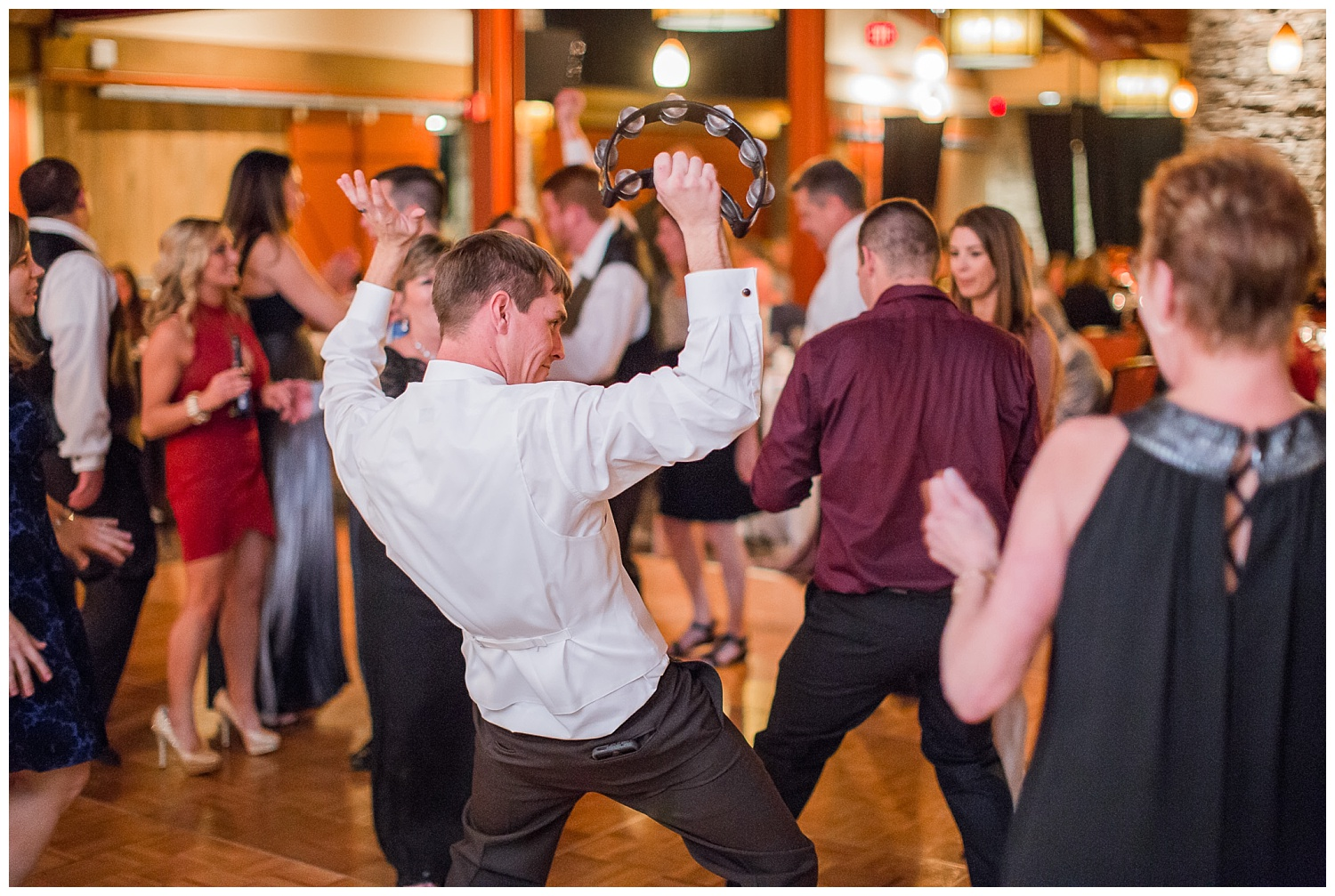 groom dances at reception