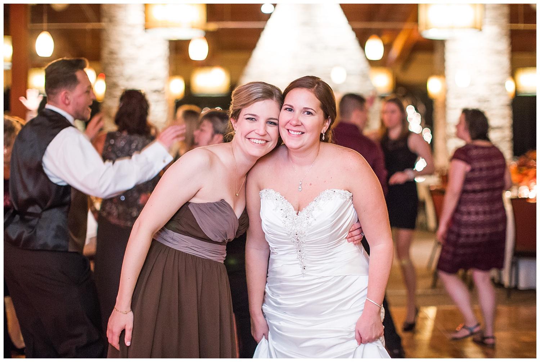 bride and bridesmaid at wedding reception