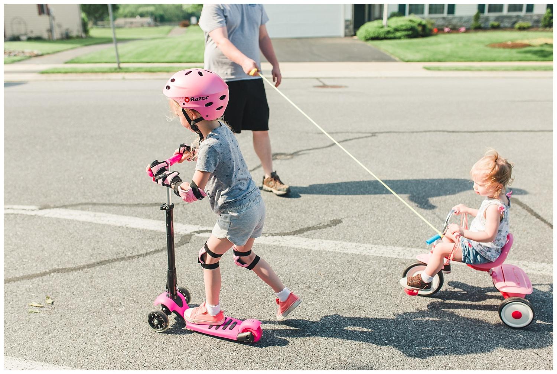 Family outdoor fun, scooter, trike, kids, neighborhood