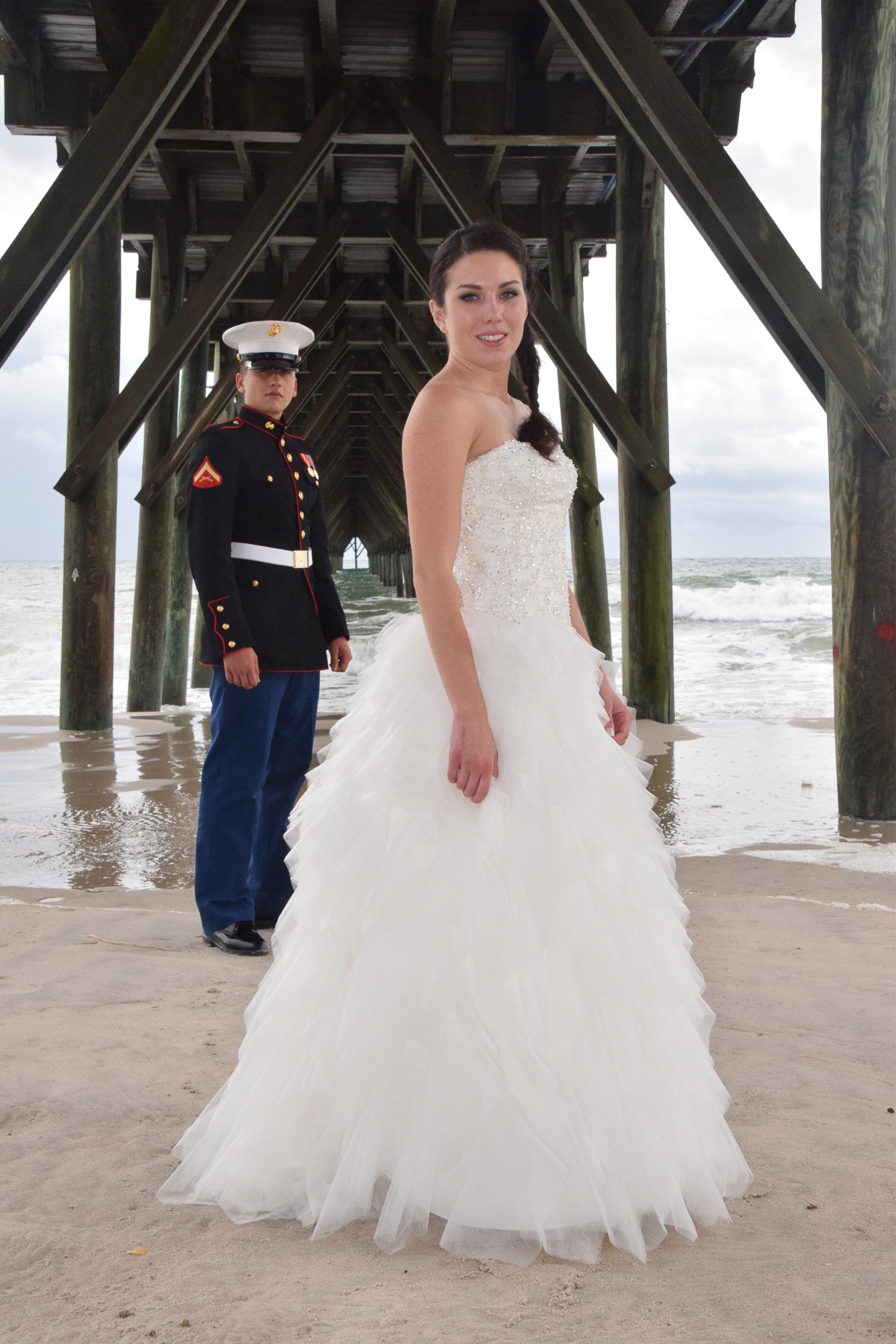 Bride and Groom under pier.