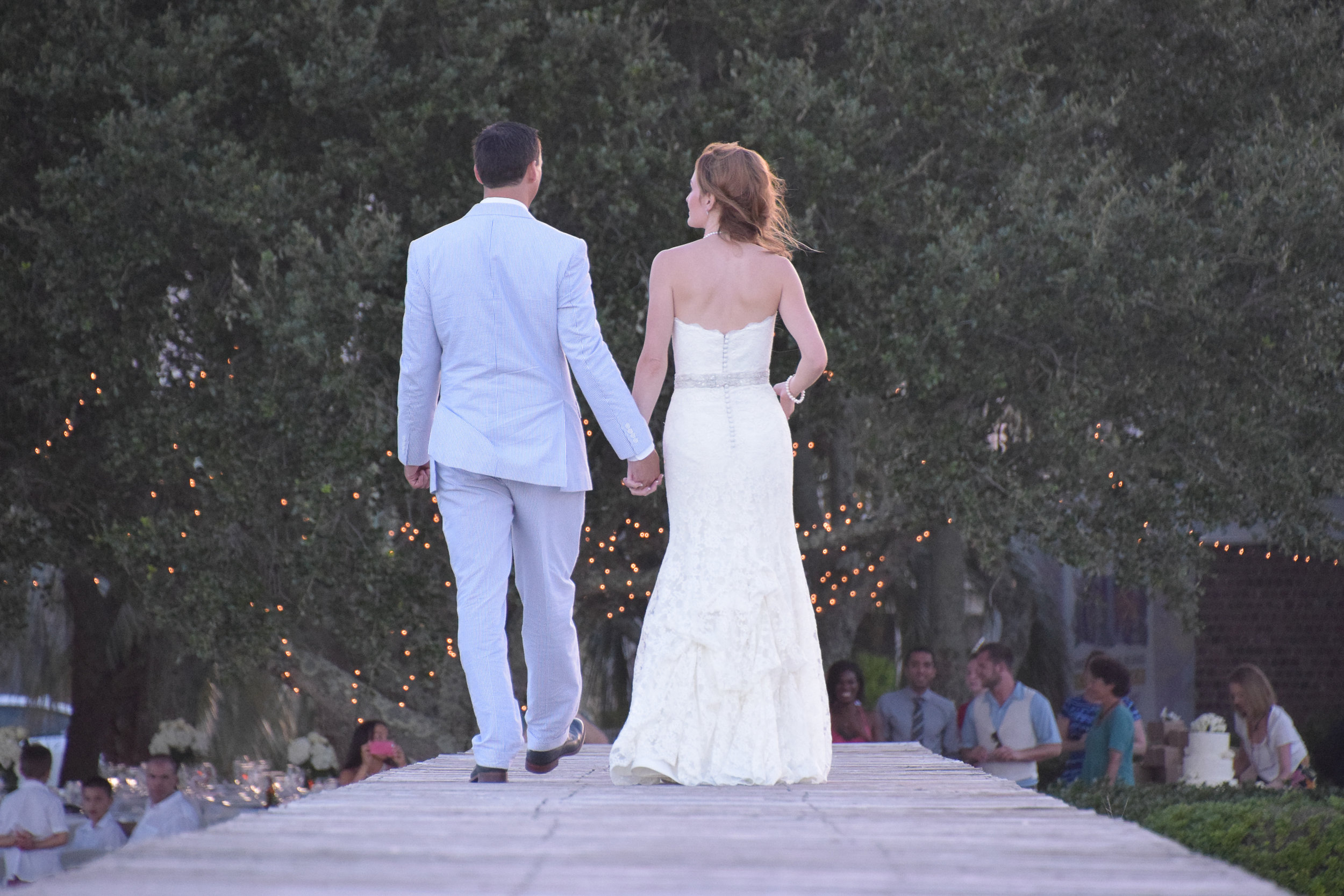 Bride and groom walking to reception.