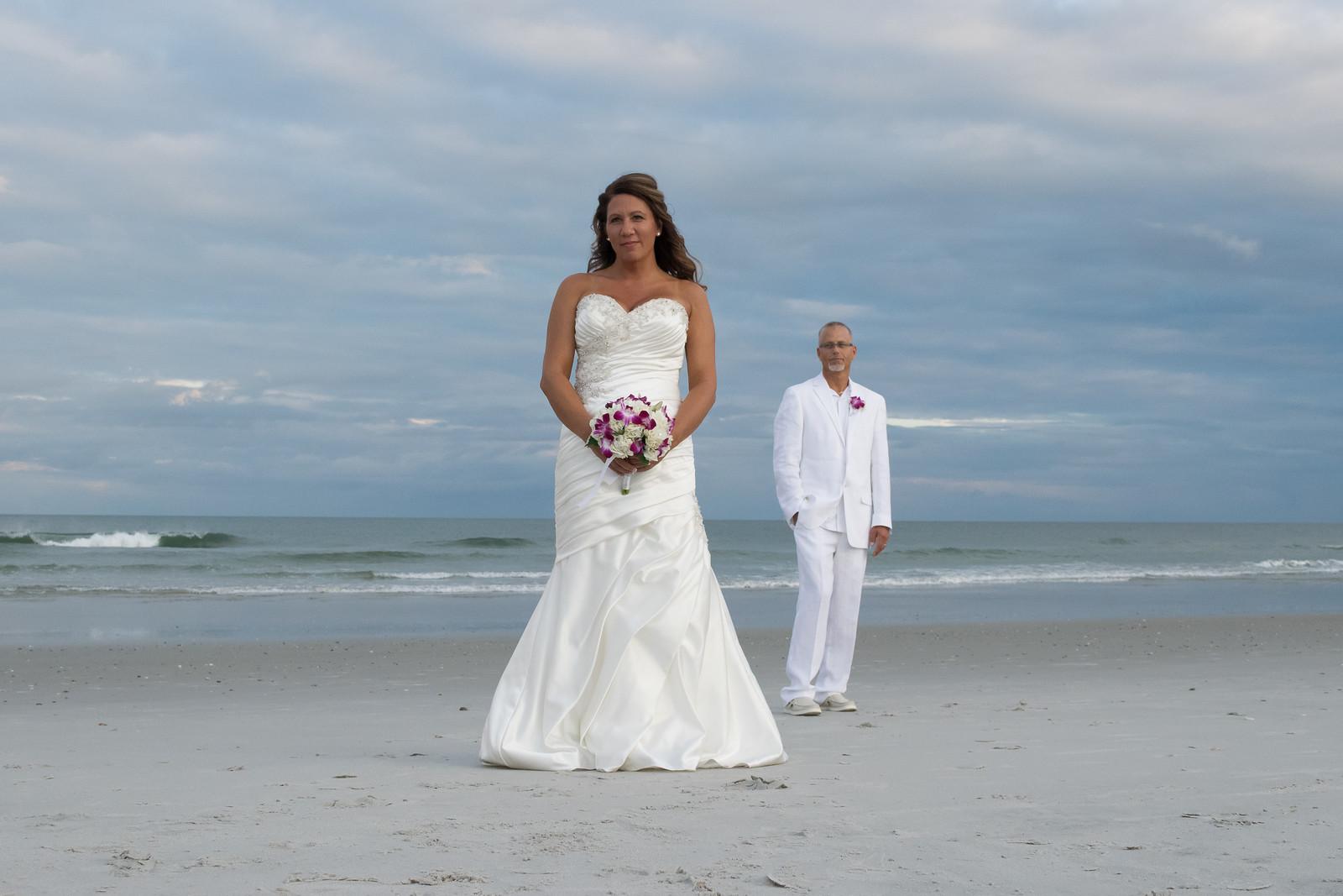 Groom admiring Bride.