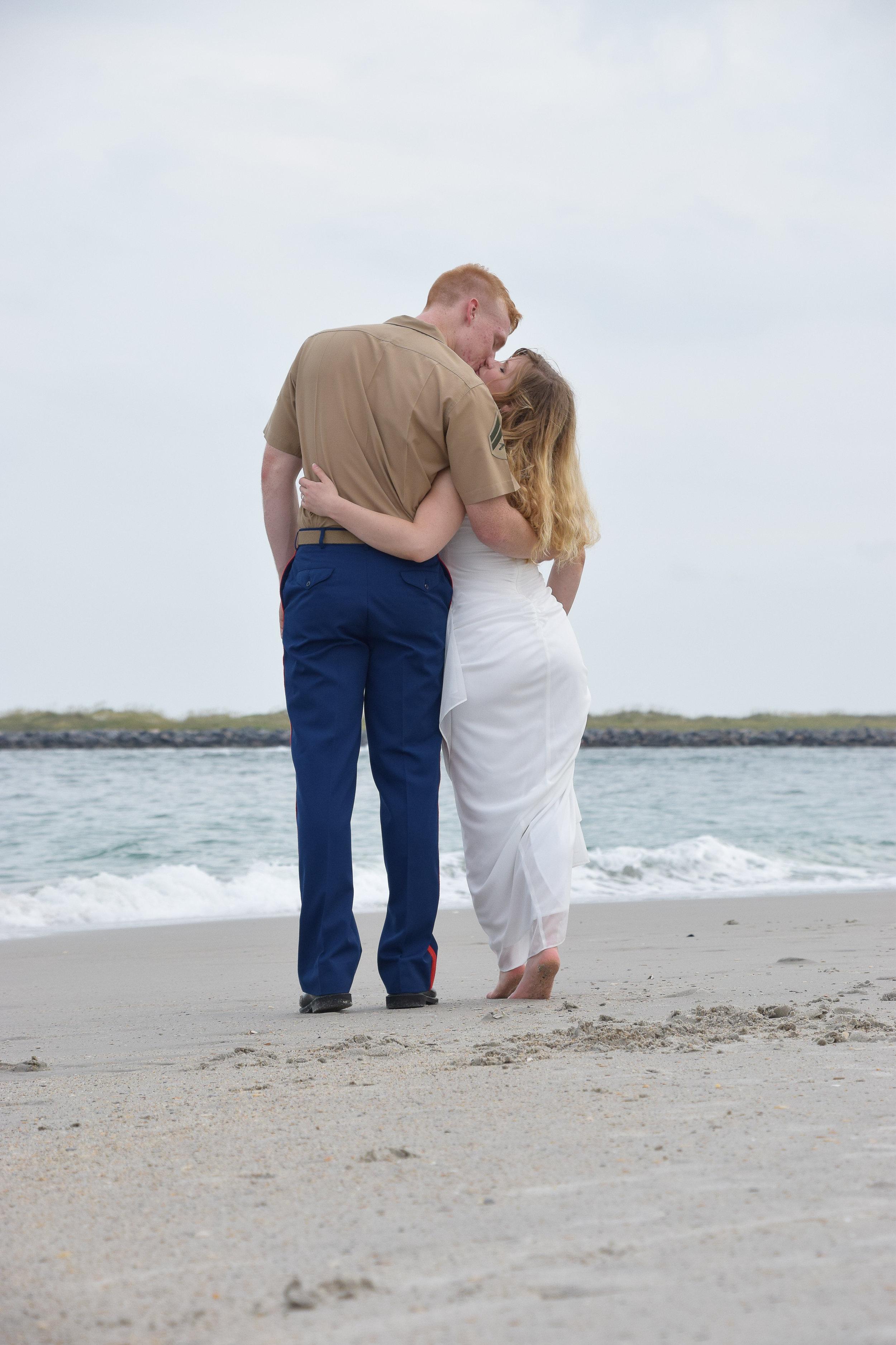 Beach walk and kiss.