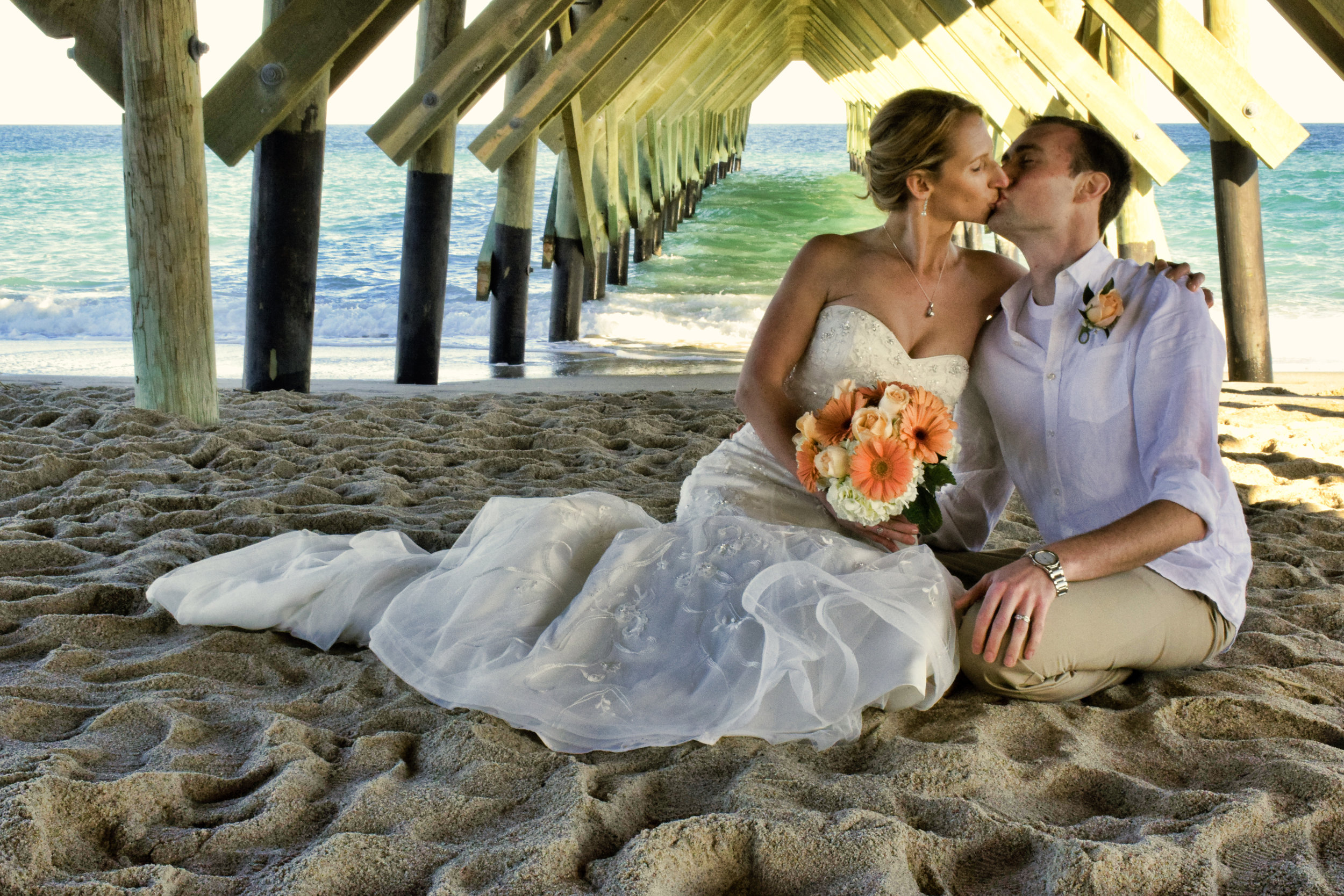 Kissing under pier.