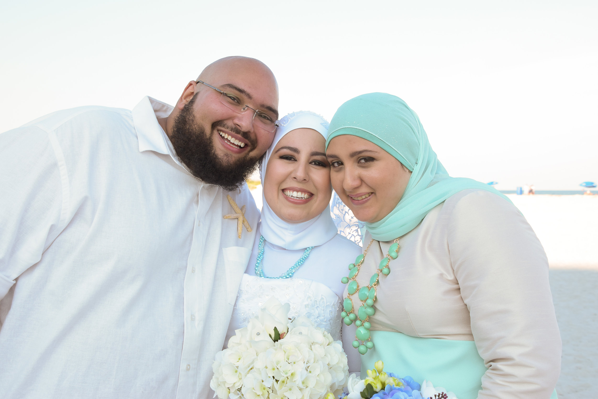 Bride posing with brother and sister.