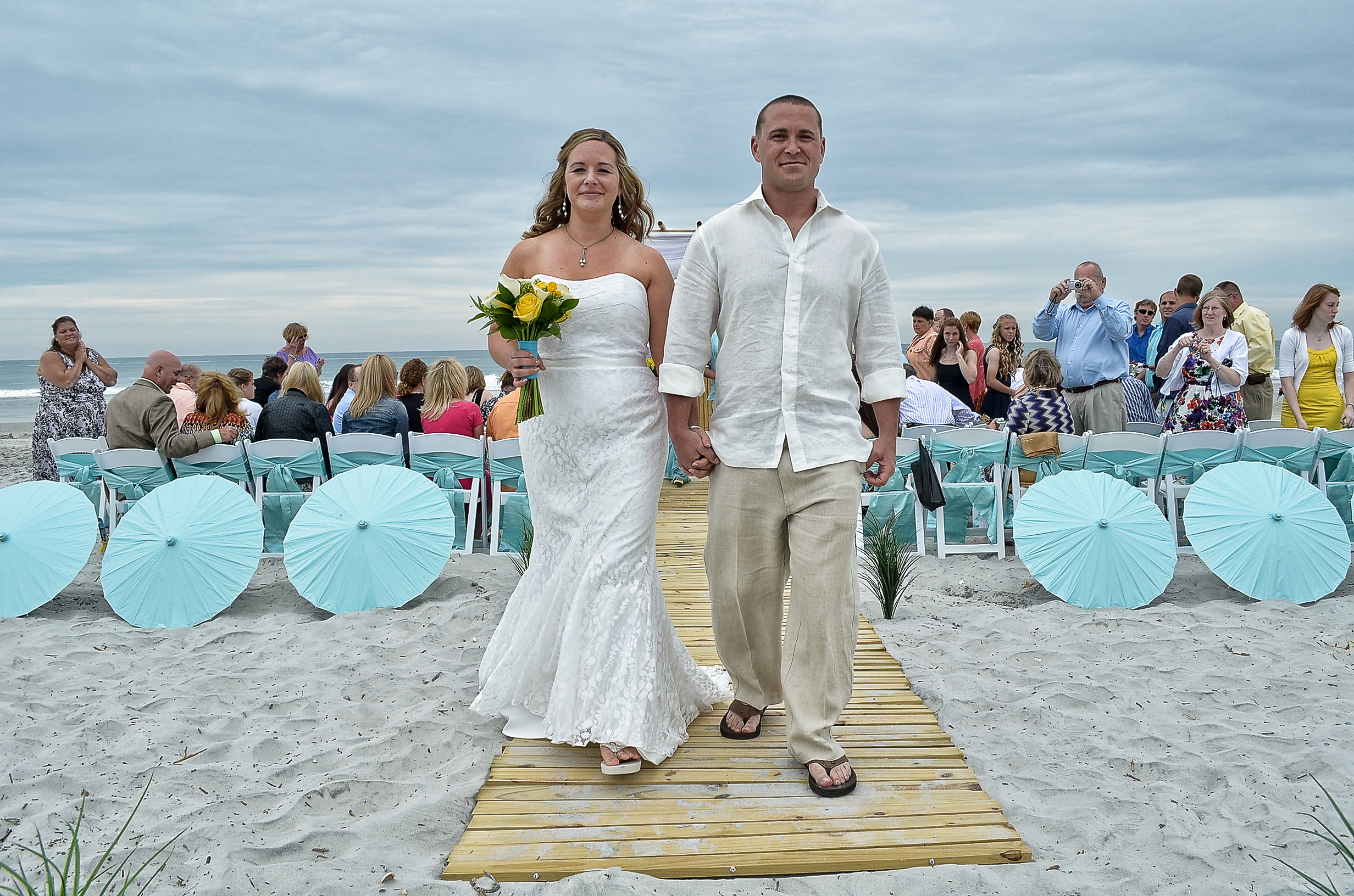 Newlyweds walking from ceremony.