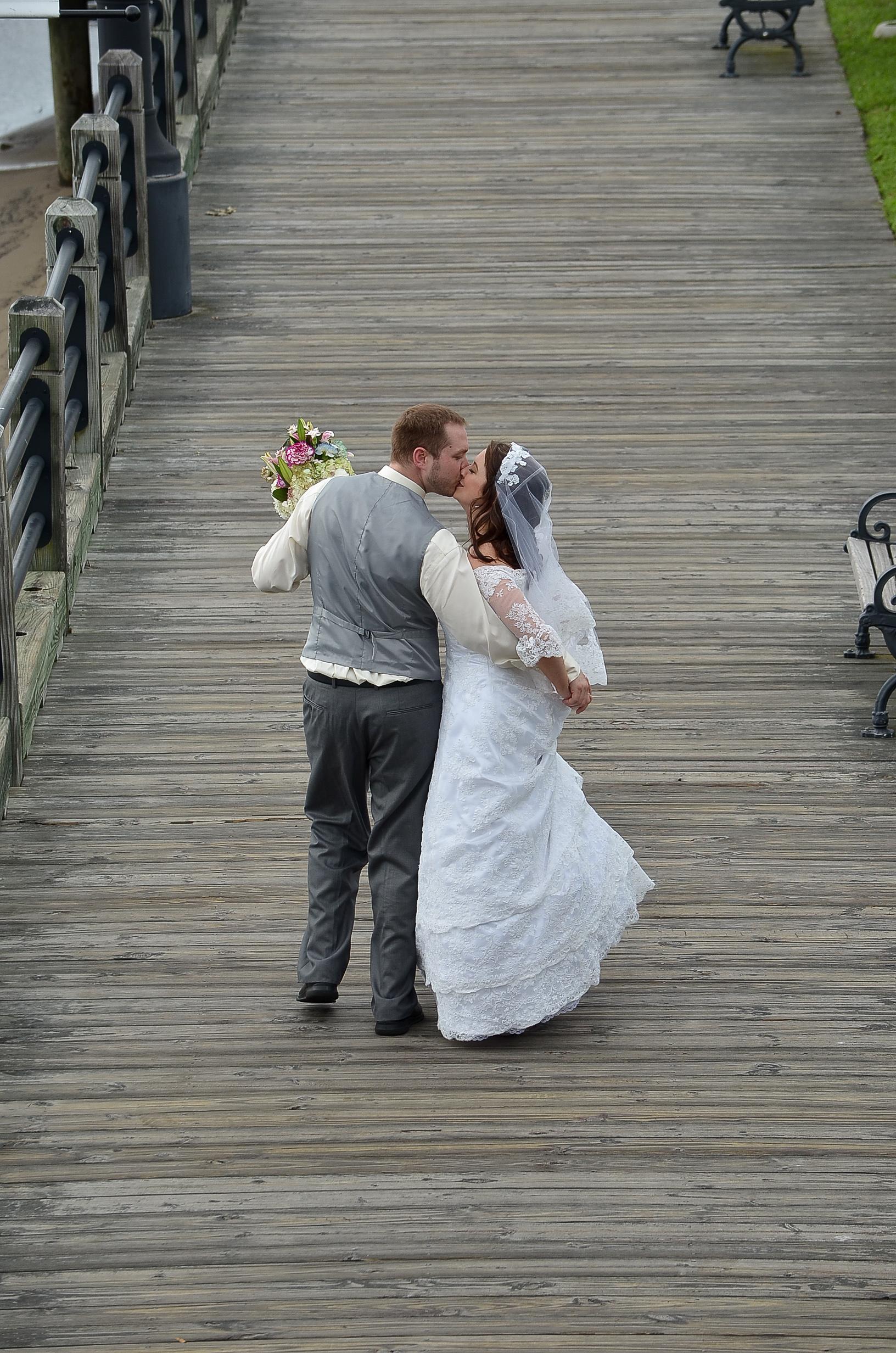 Bride and groom walk.
