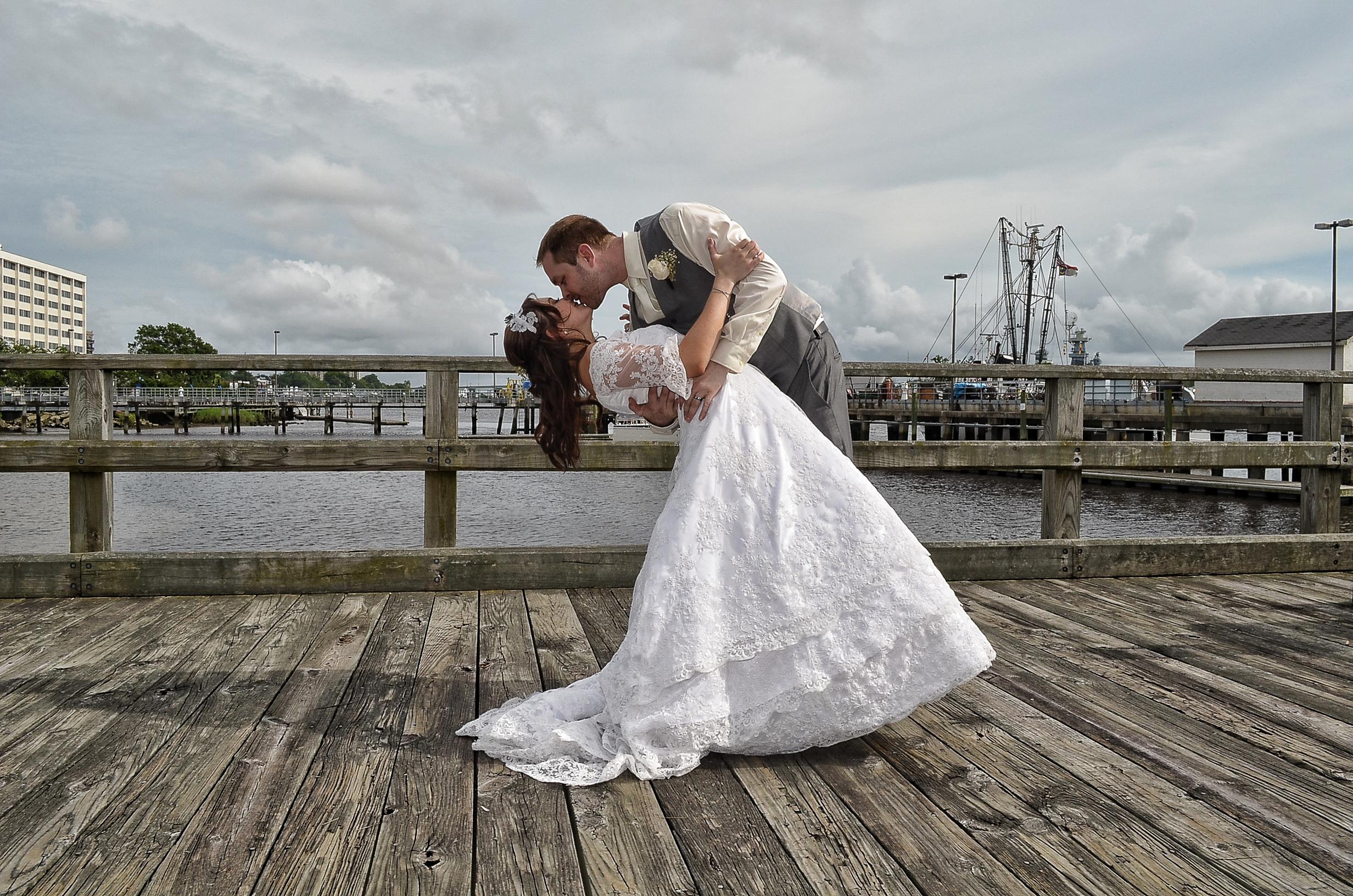 Groom dipping bride.