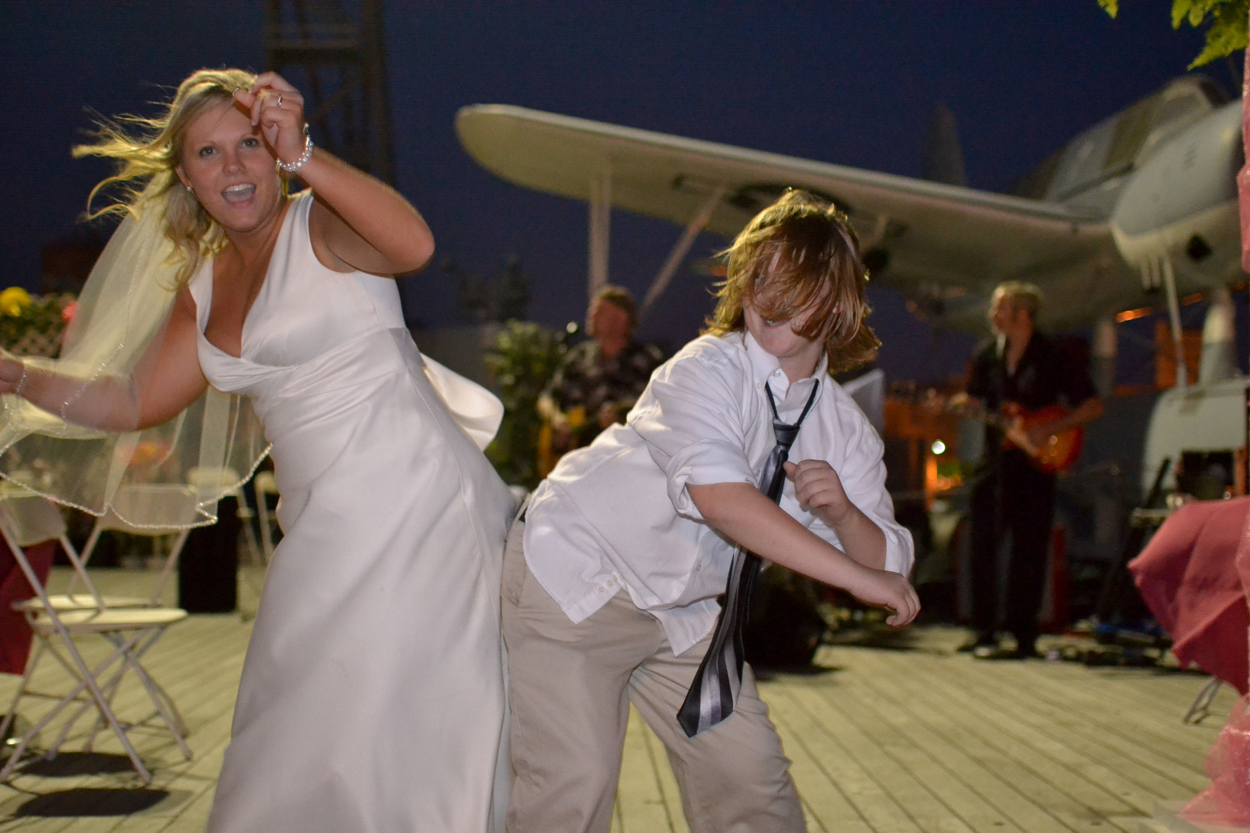 Bride dancing with guest.