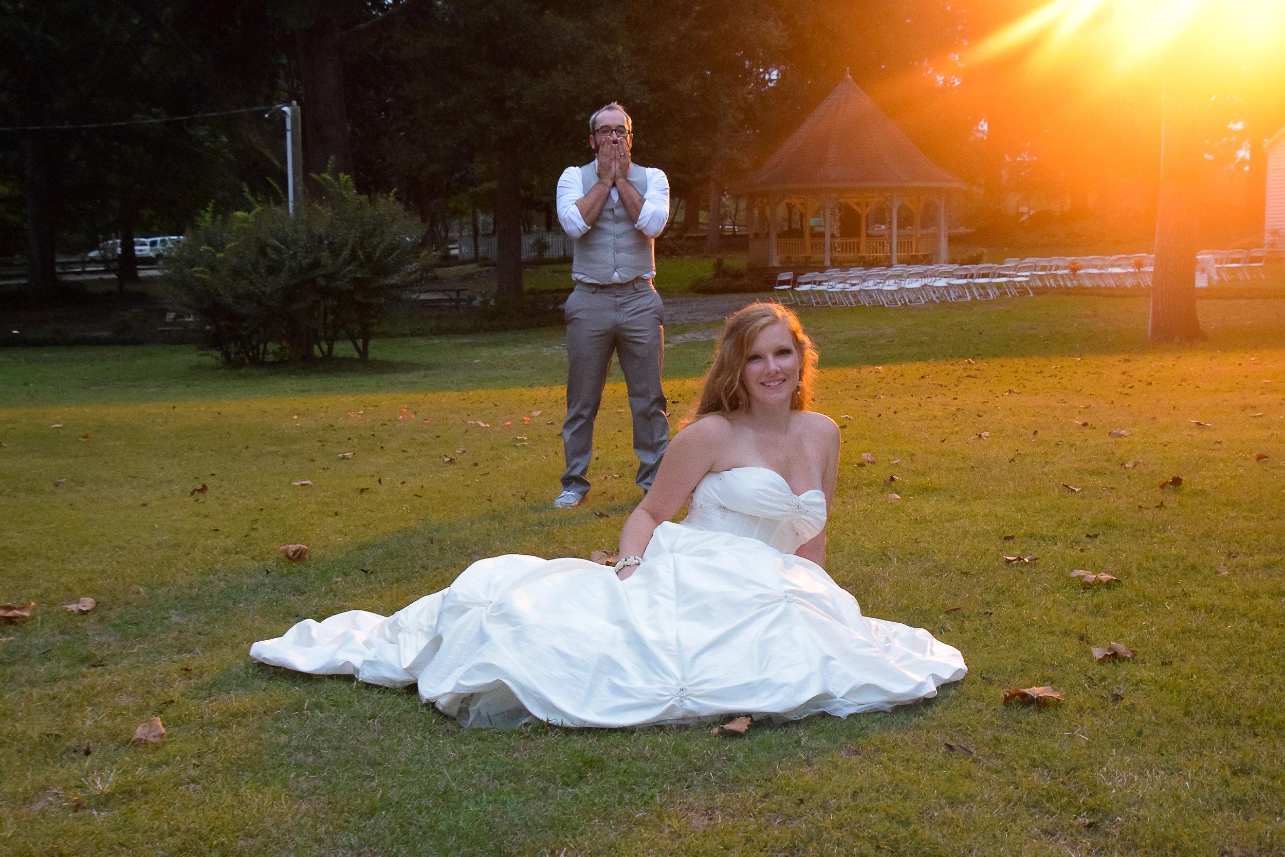 Groom standing in awe of his bride.