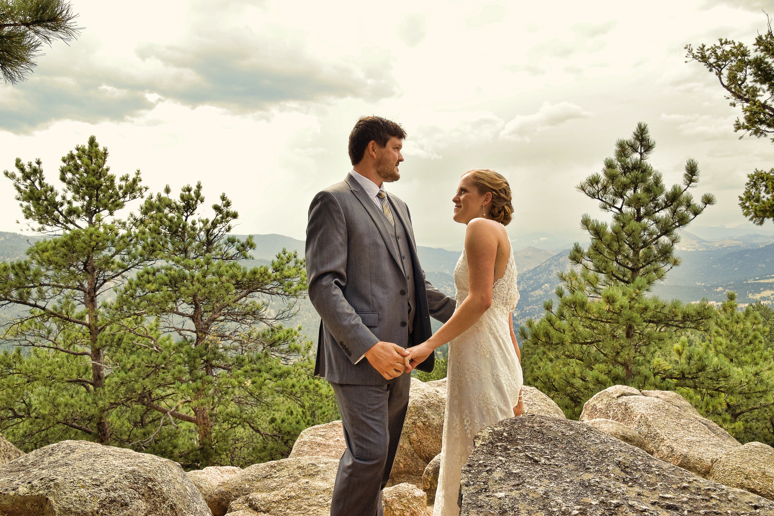 Candid shot of bride and groom in mountains.