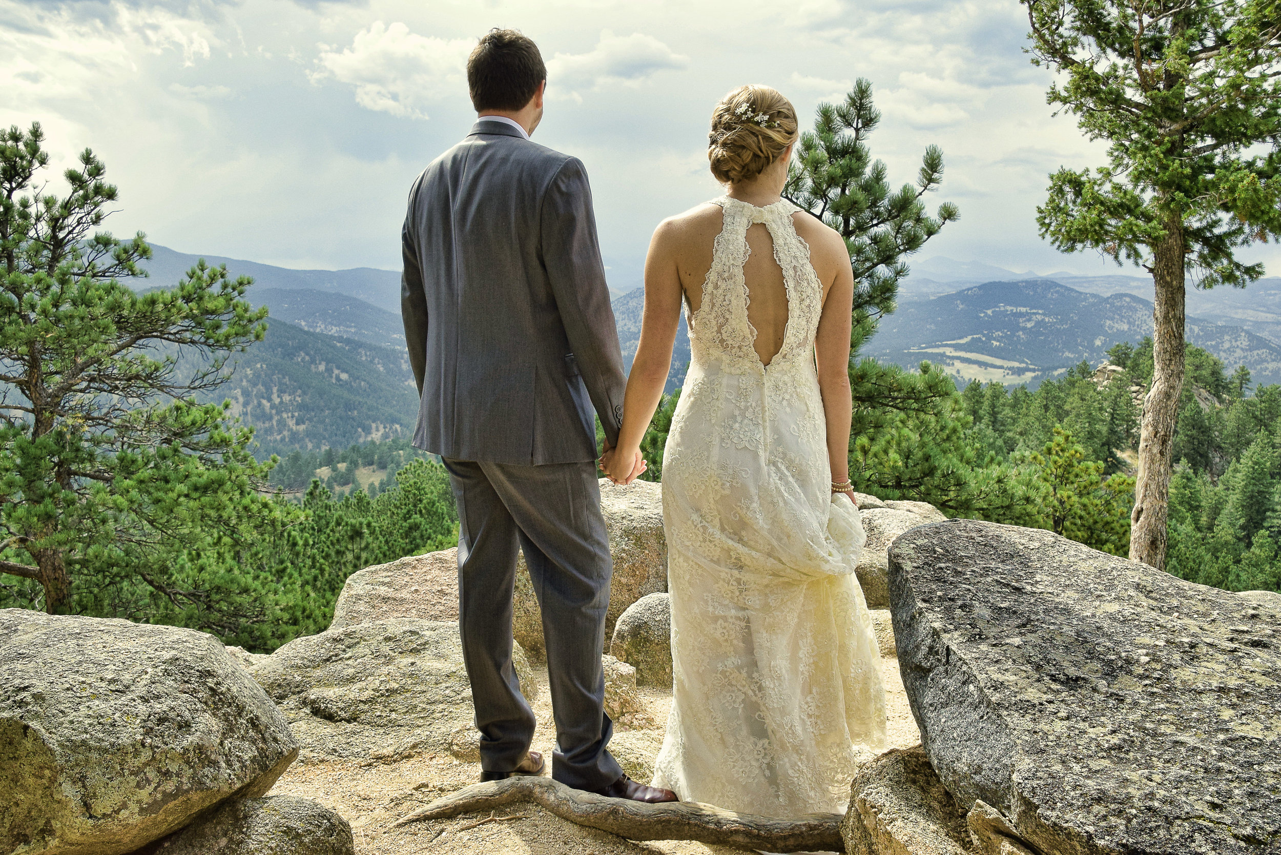 Candid shot of bride and groom in Rocky Mountains.