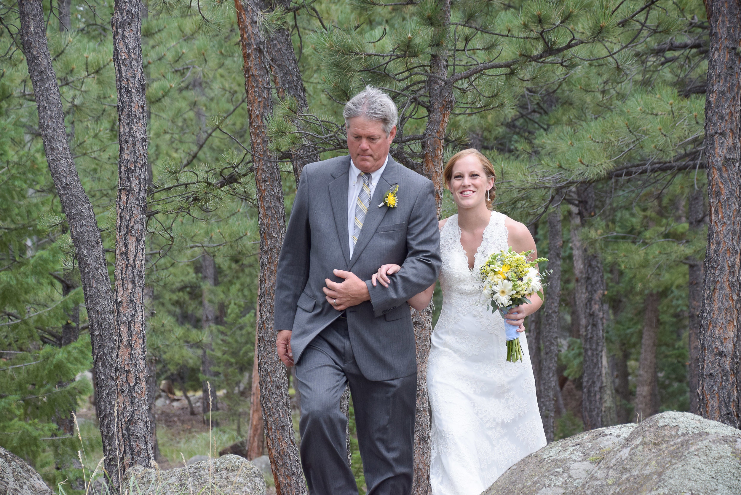 Dad walking daughter to wedding ceremony.