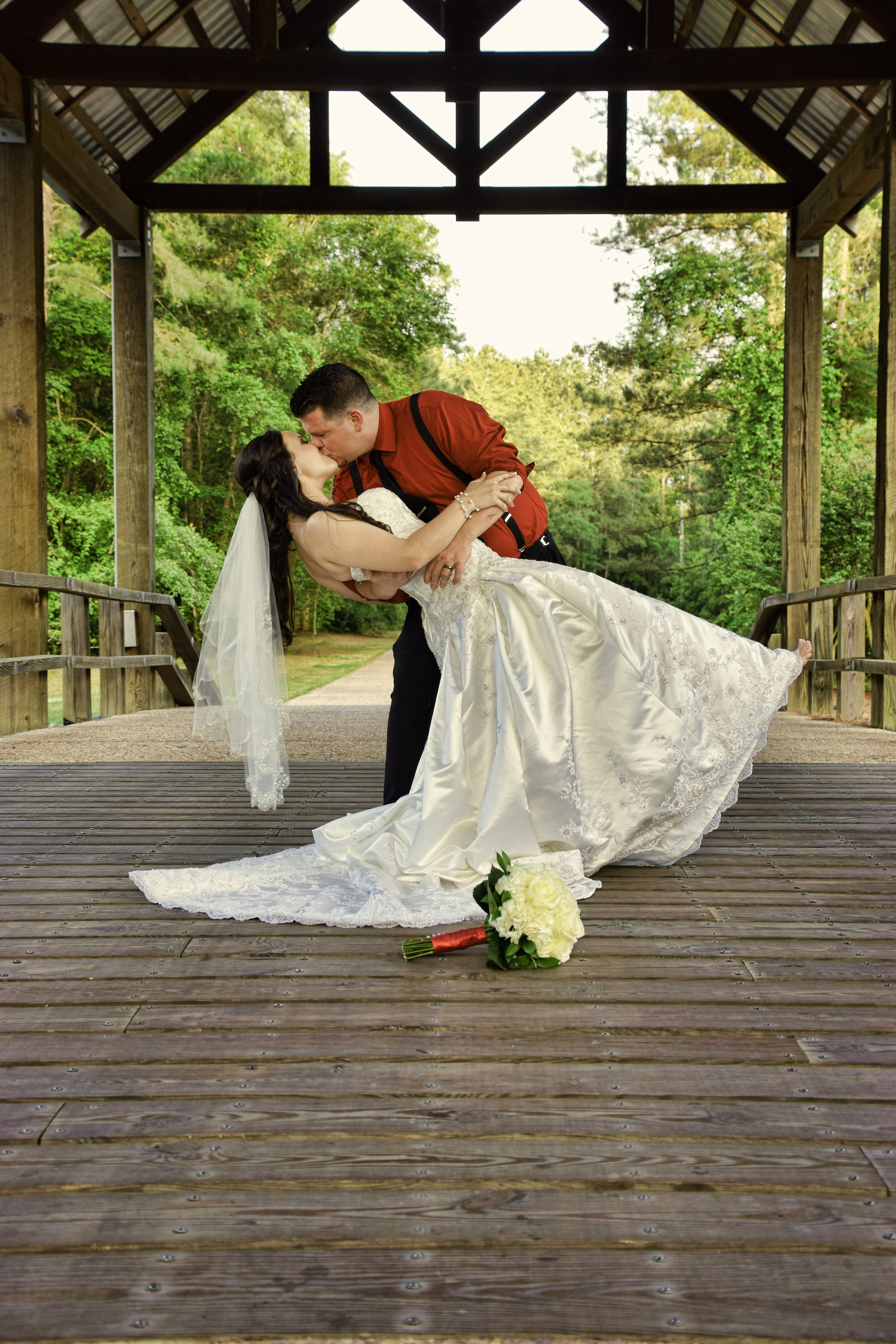 Bride and groom dip.