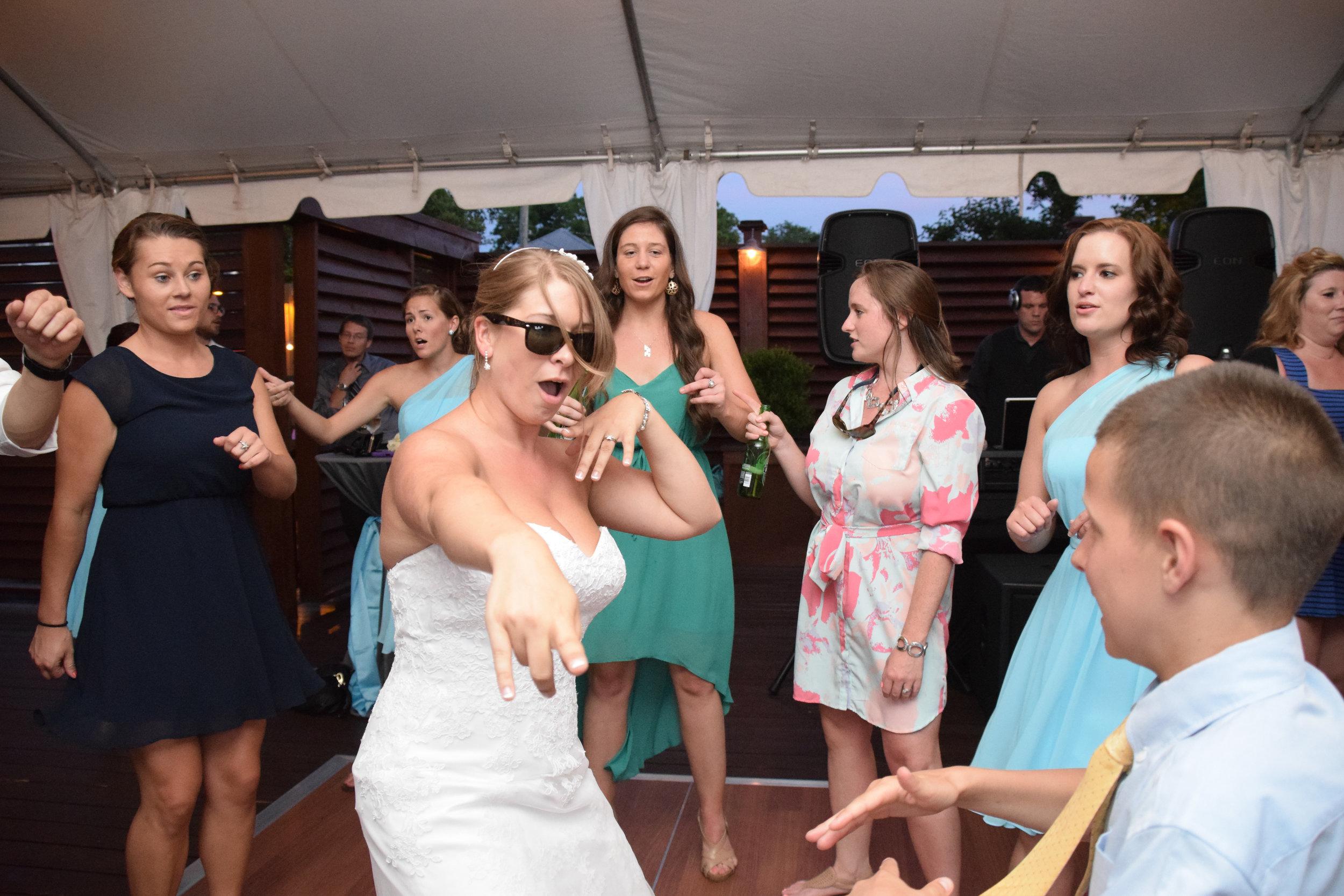 Bride dancing at reception.