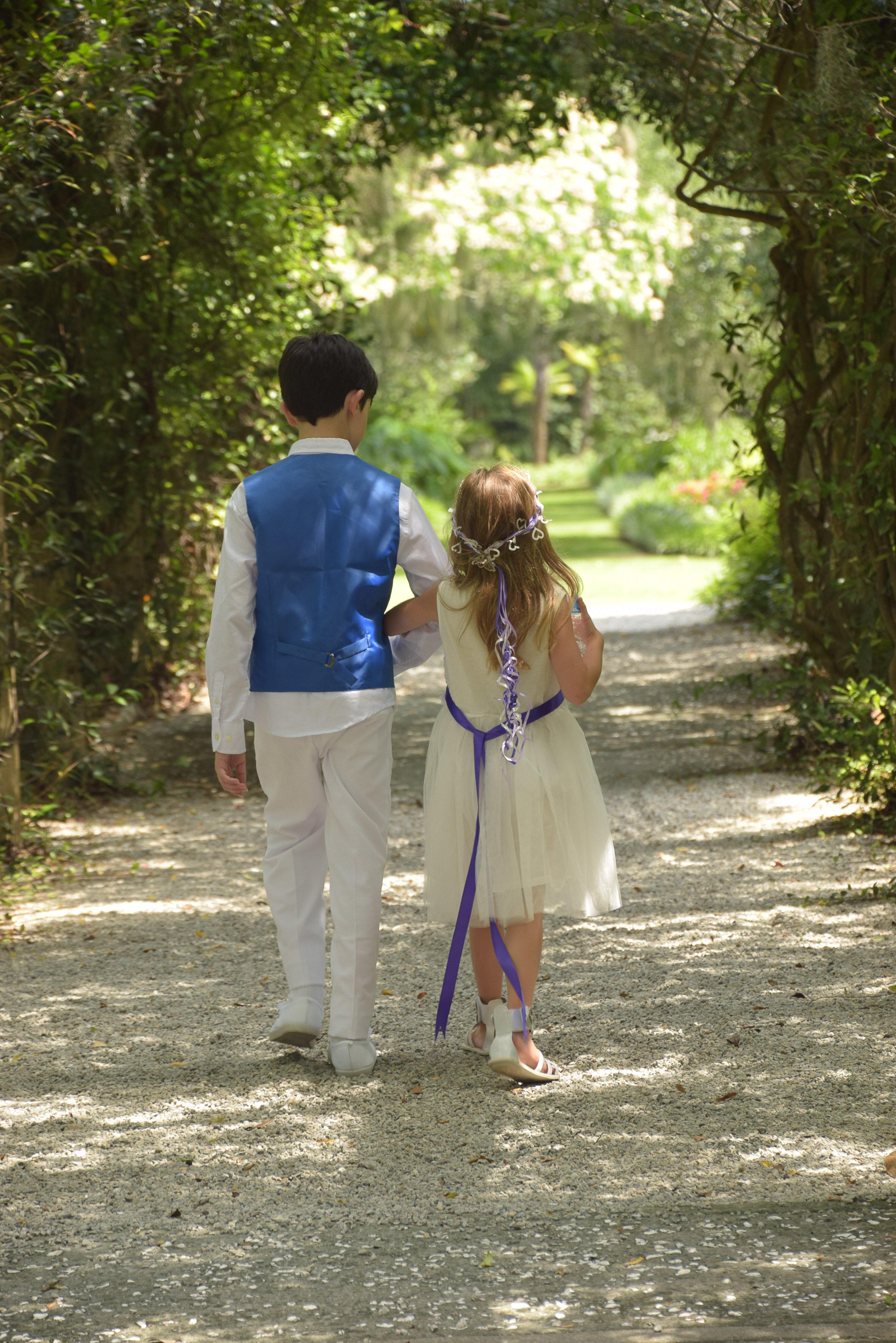 Flower girl and ring bearer walk.
