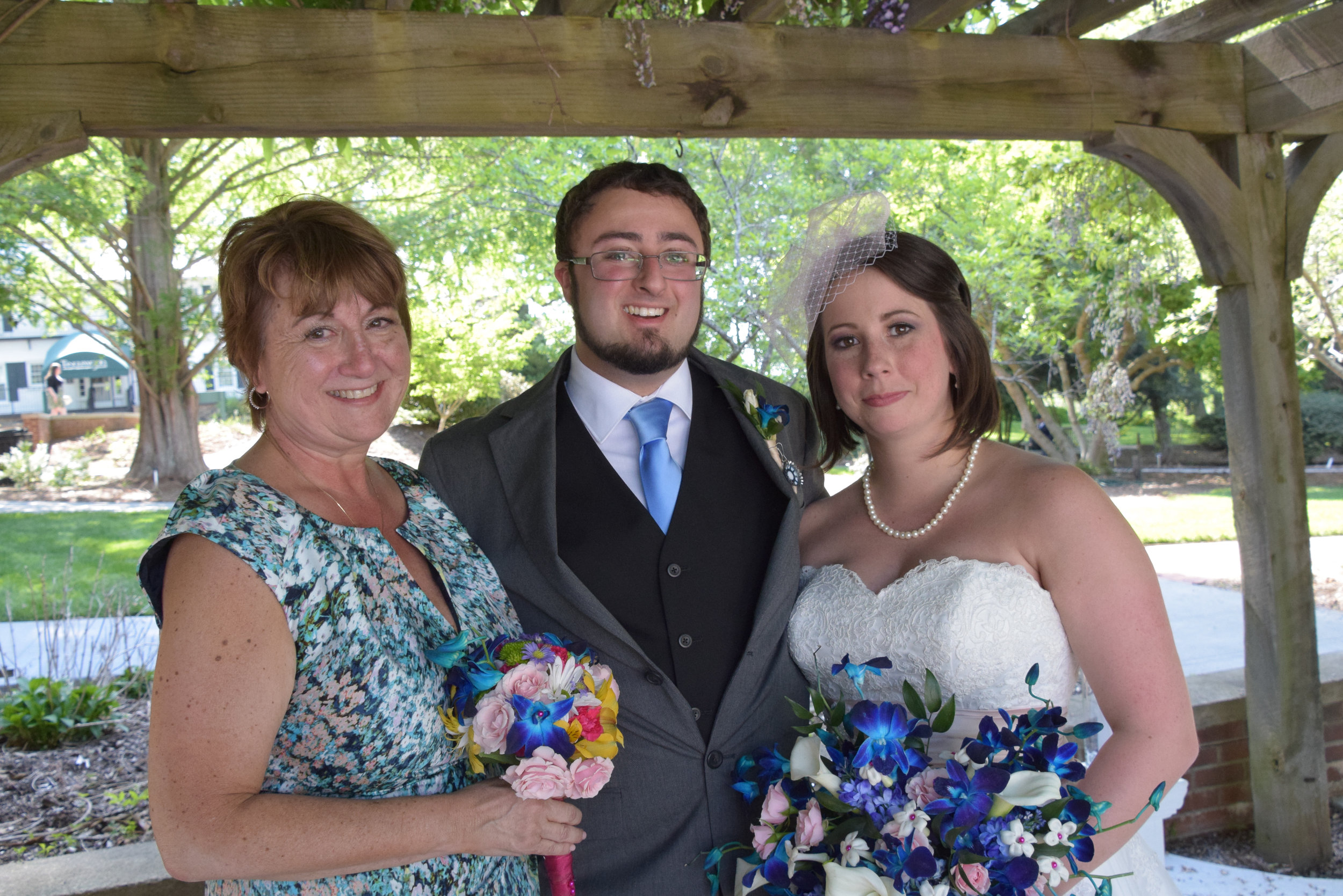 Bride, groom and mom.