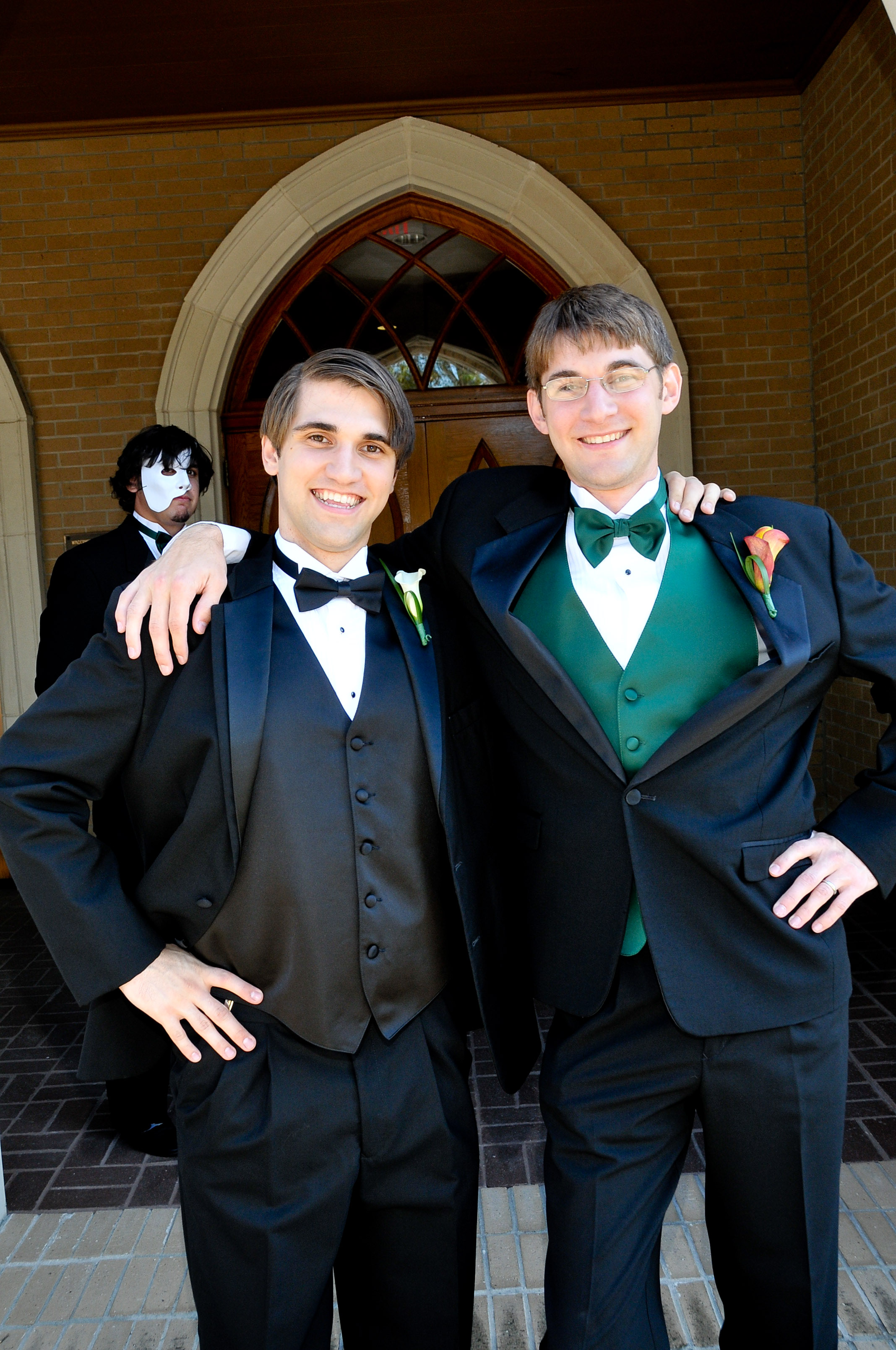 Groom and brother photobombed by Phantom of the Opera.