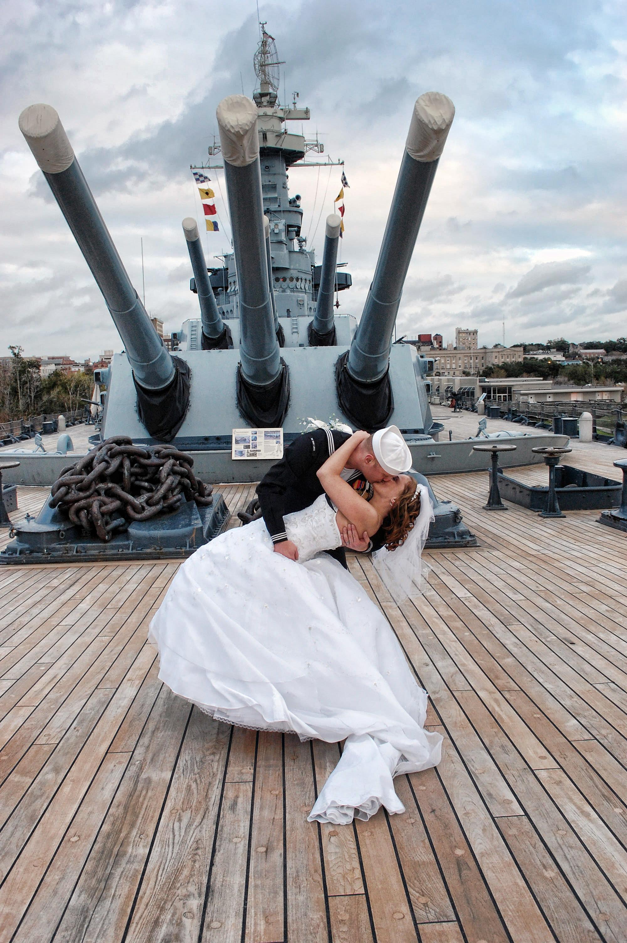 Kiss under the guns.