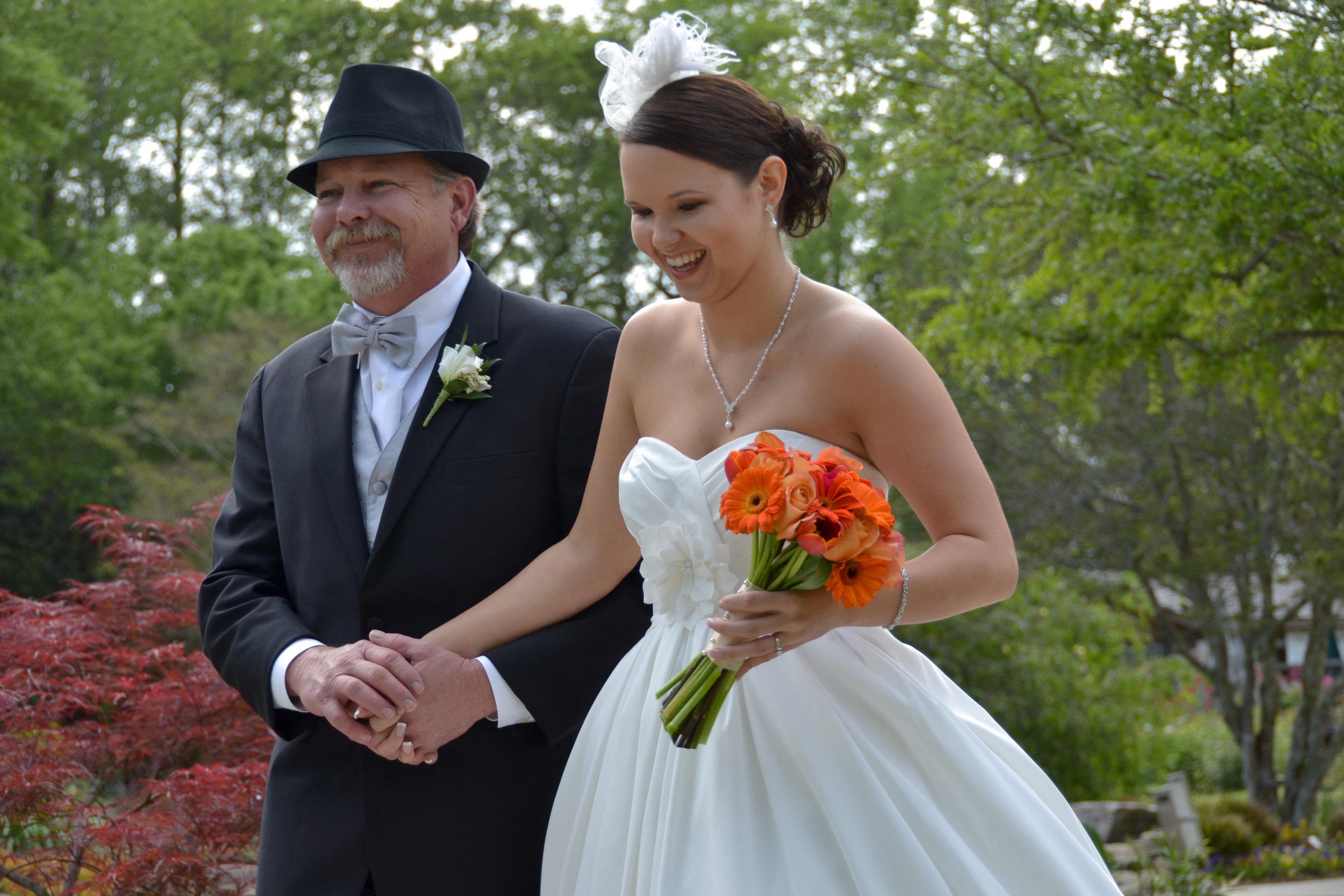 Candid Shot of dad walking daughter to wedding.