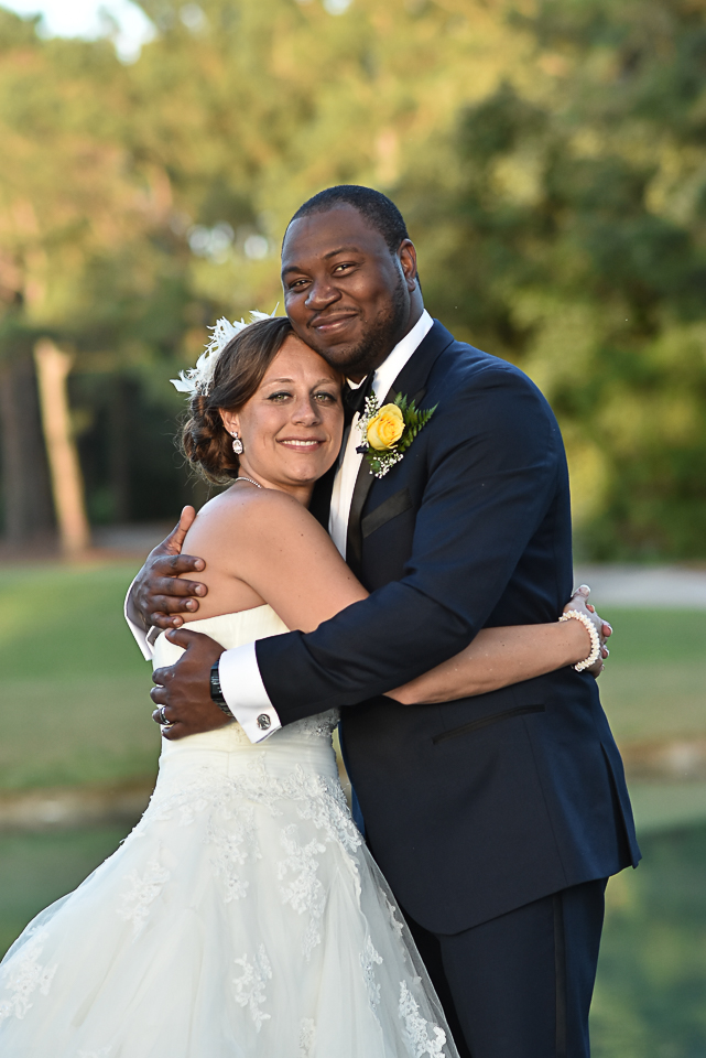 Posed portrait of bride and groom at Porters Neck Country Club.