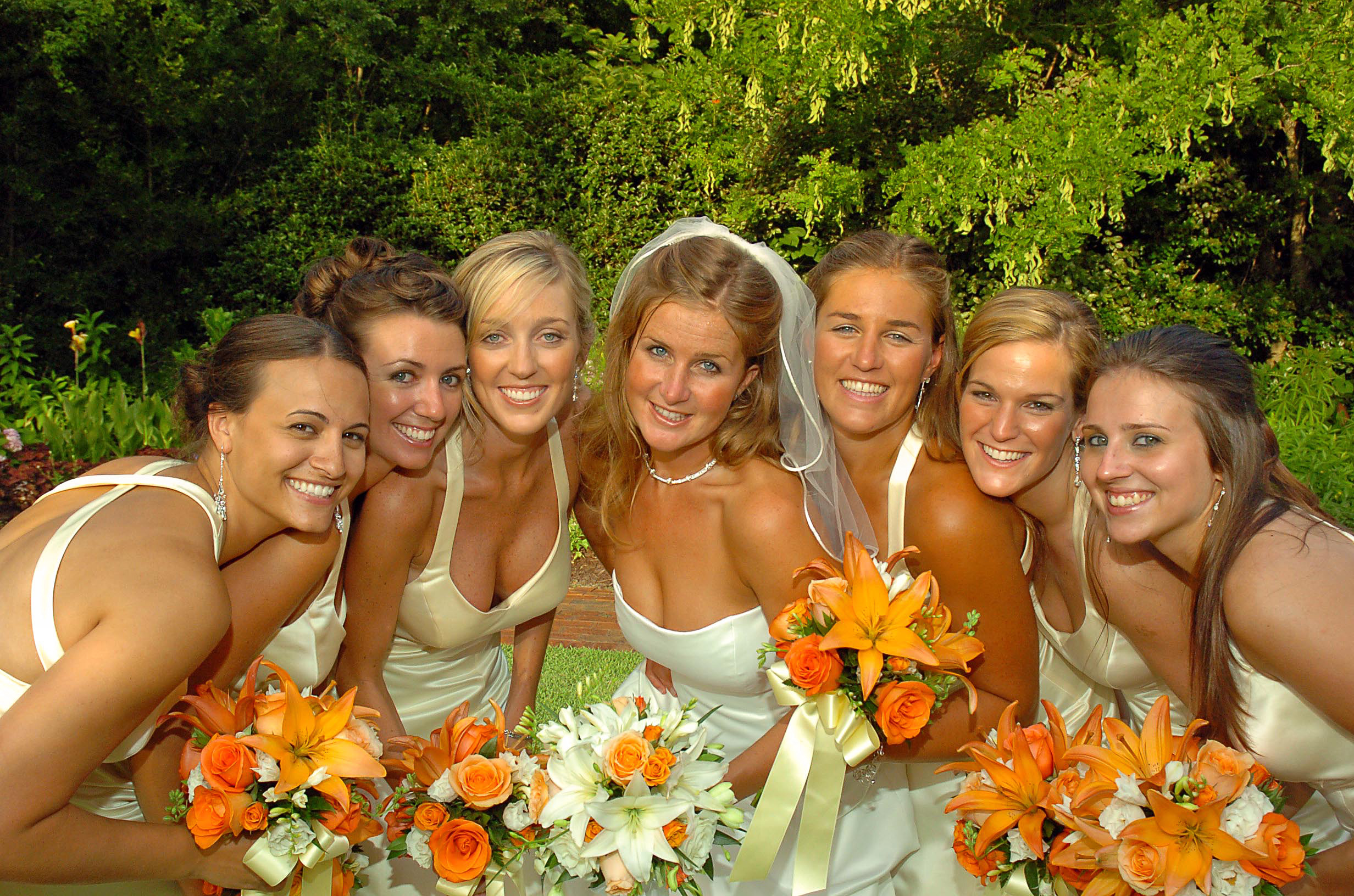 Bride and bridesmaids posed photo.