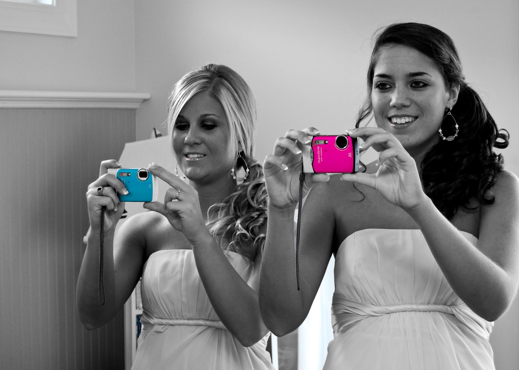 Bridesmaids with cameras.
