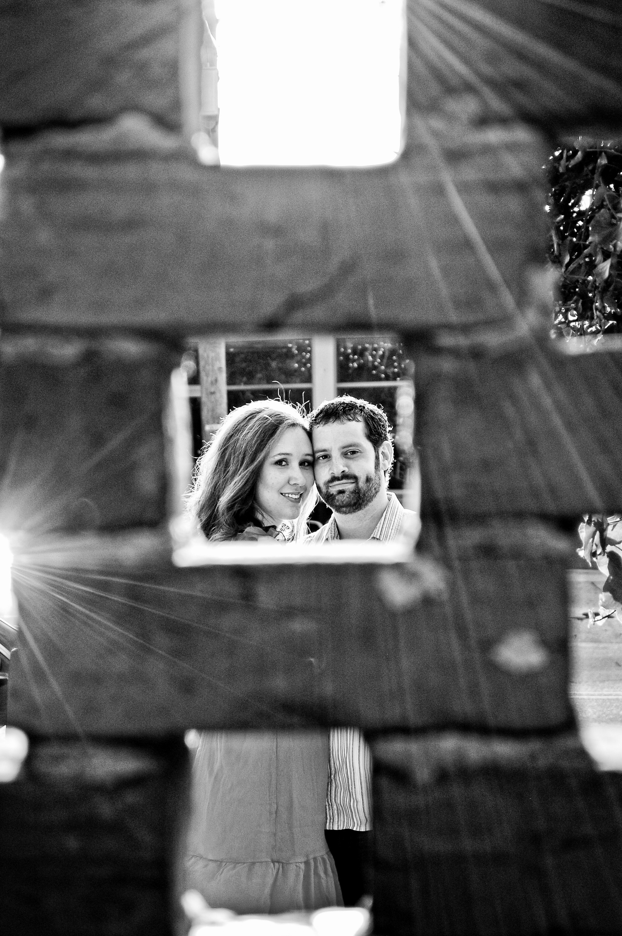 Couple shot through bricks.