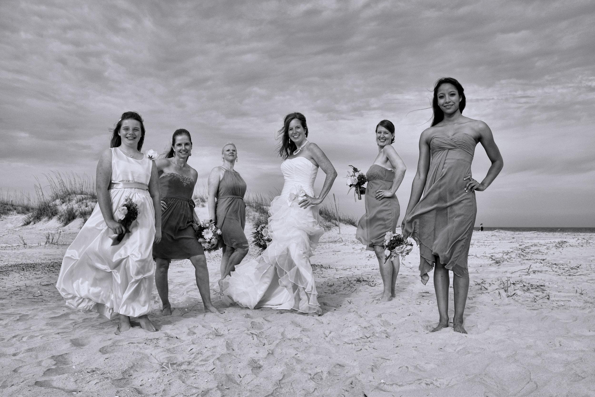Bride and bridesmaids posing.