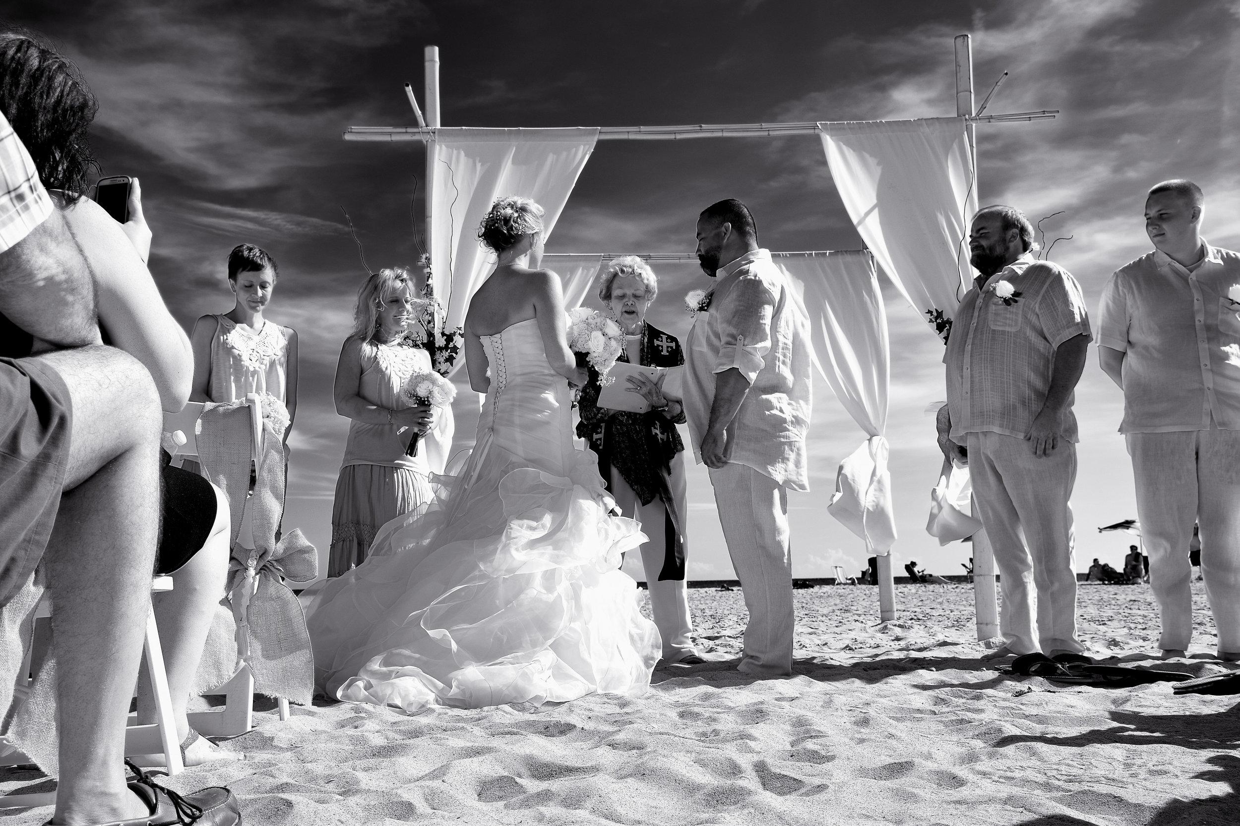 Black and white beach ceremony.