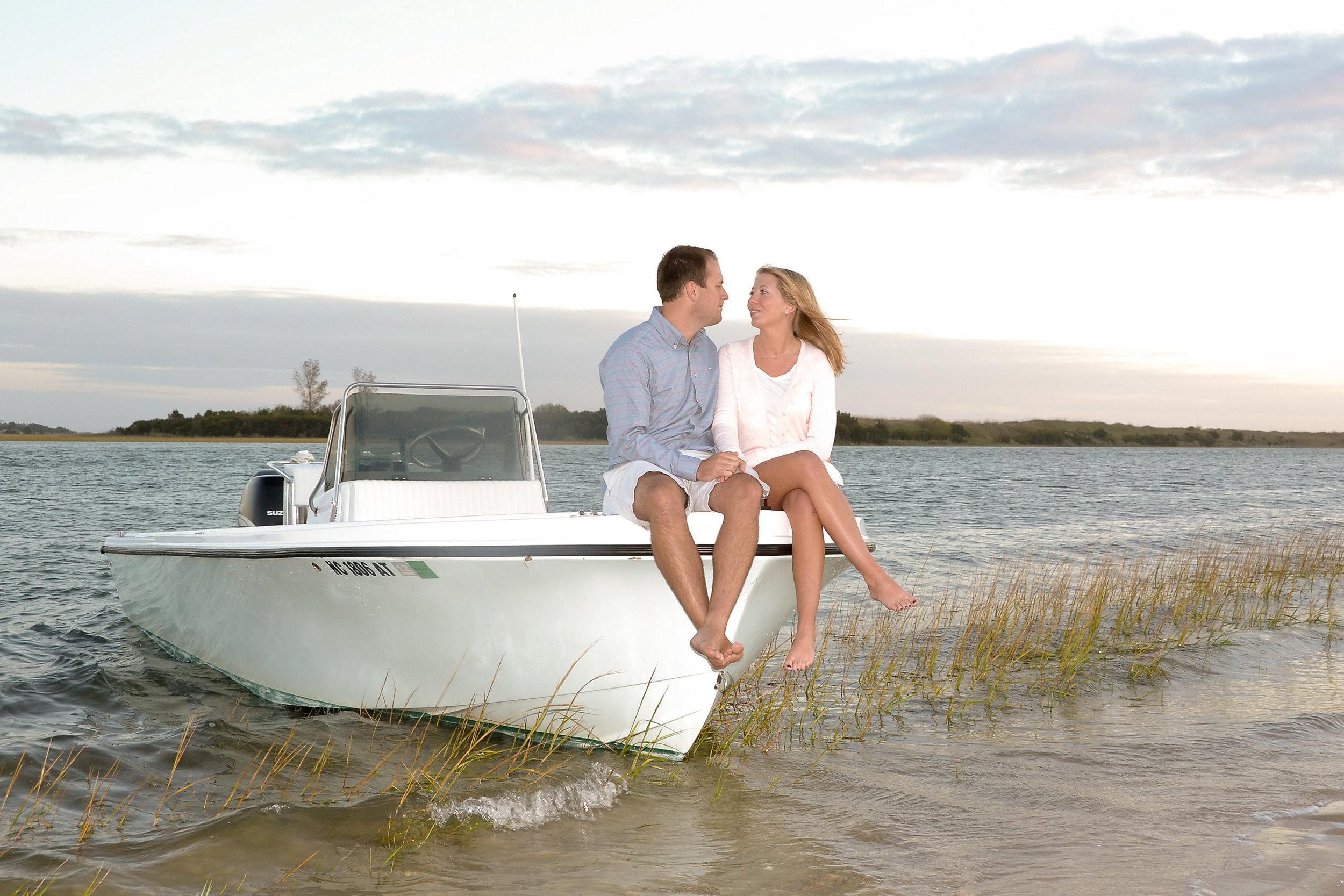 Candid engagement portrait. on boat.