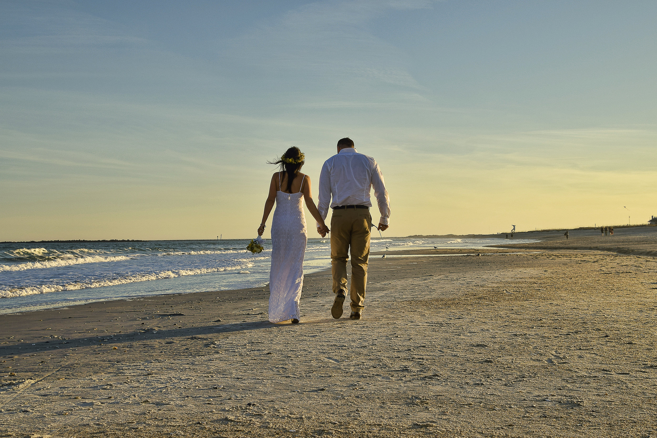 - Taking a walk on the beach post ceremony in Wrightsville Beach, NC.