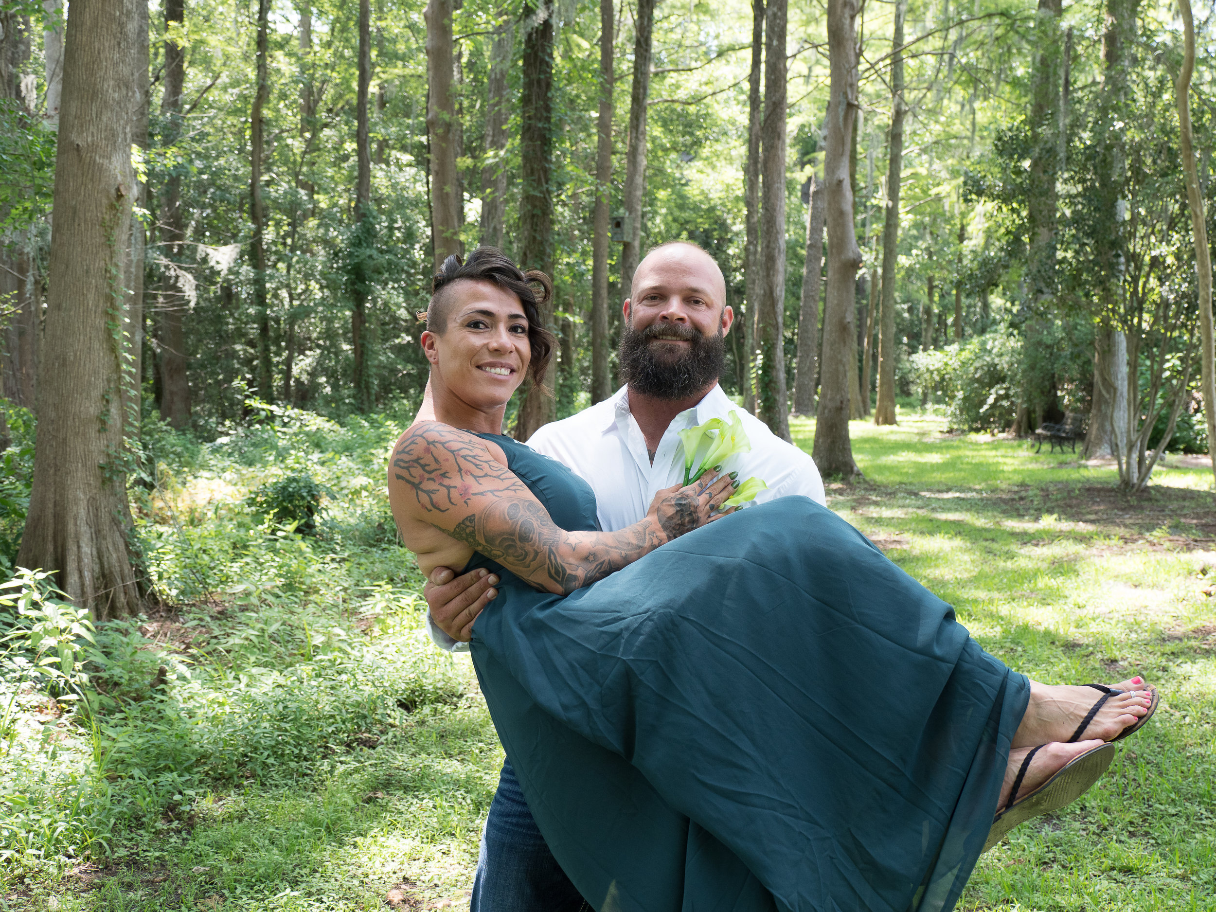 Green - Beautiful bride in a green dress on her wedding day at Greenfield Lake in Wilmington, NC.