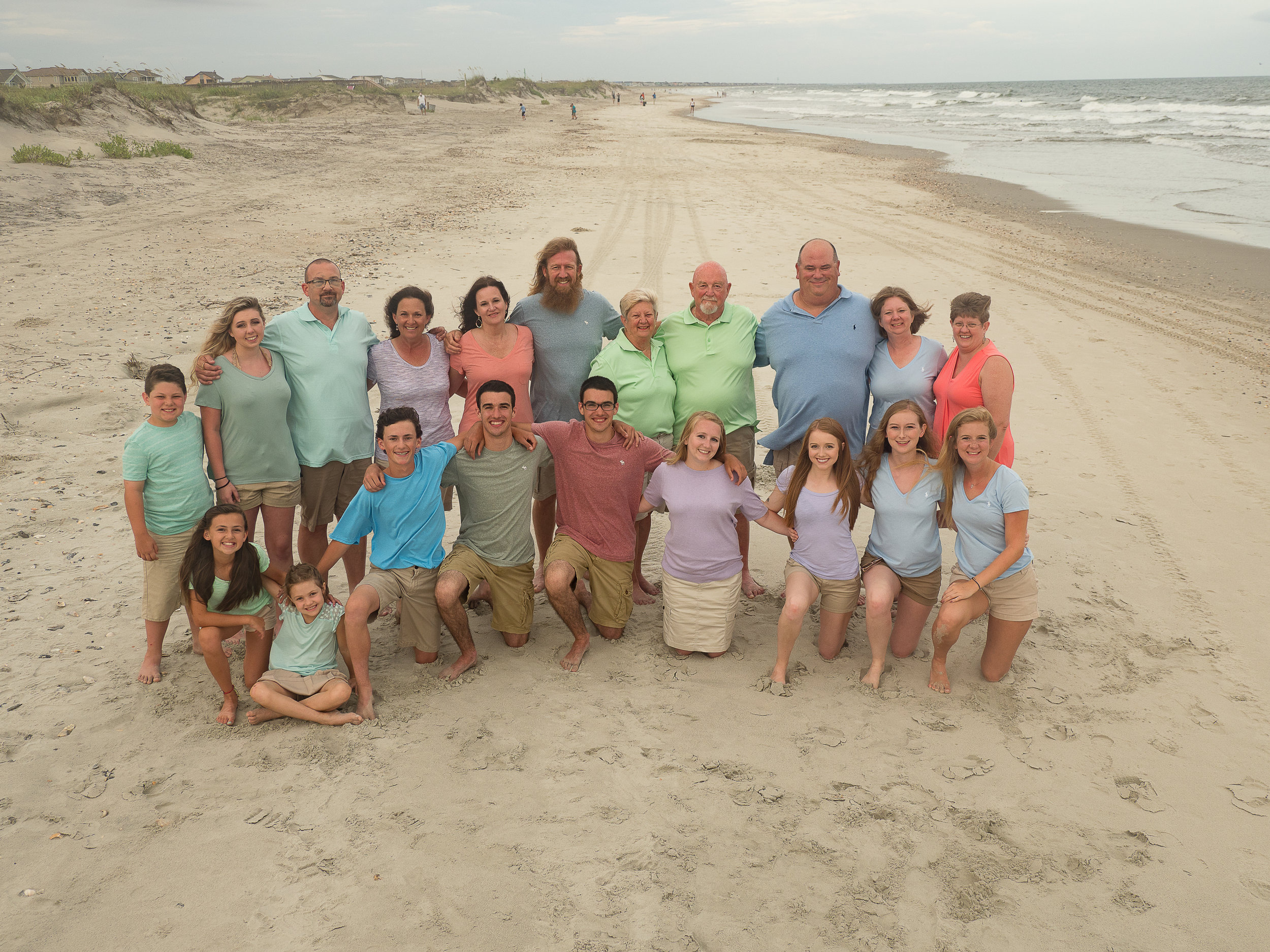 - Love the different color shirts and the sweep of beach in the background. This is why I bring a ladder. Holden Beach, NC.