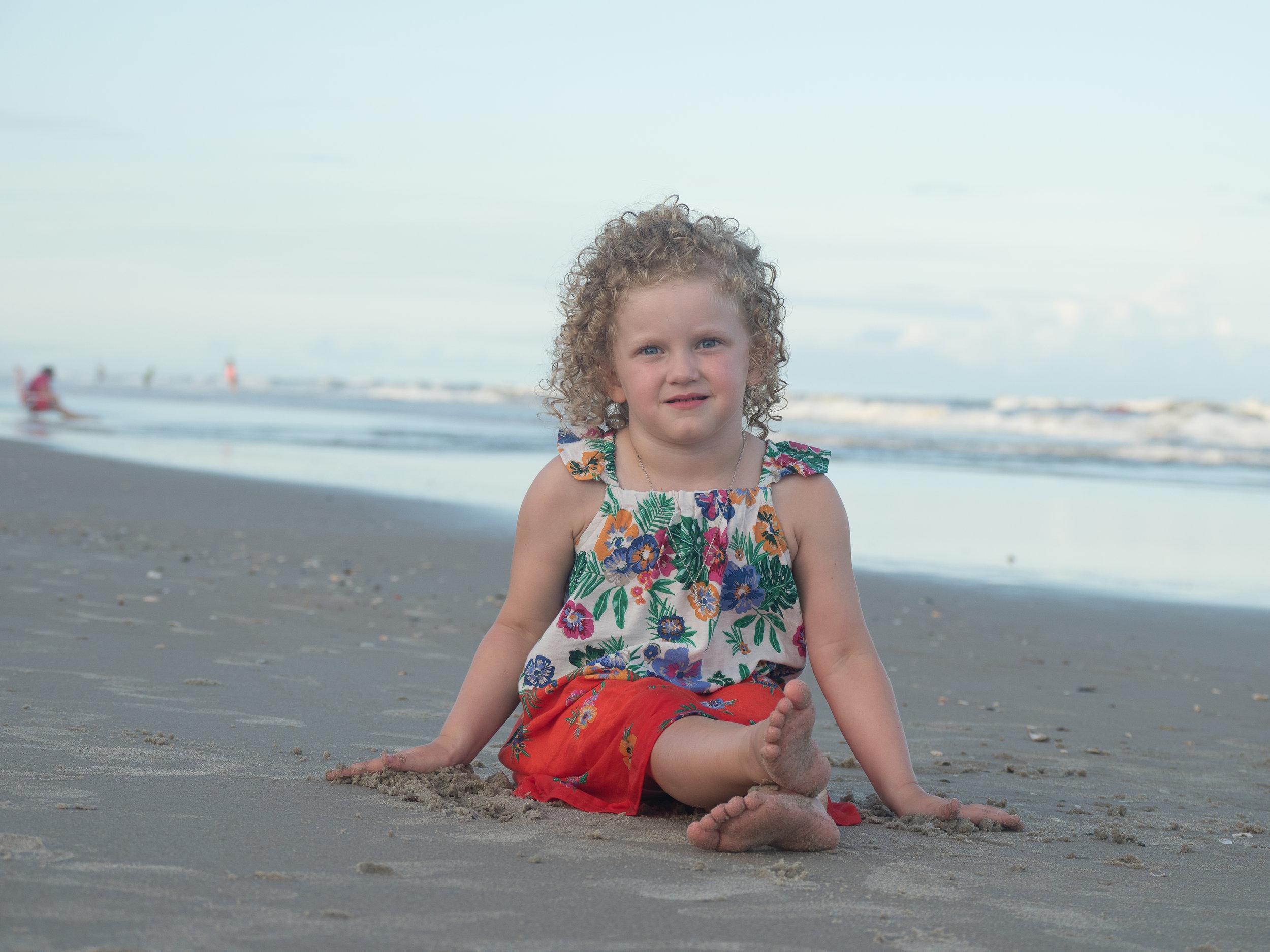- Cute portrait of little girl on beach. Topsail Island, NC