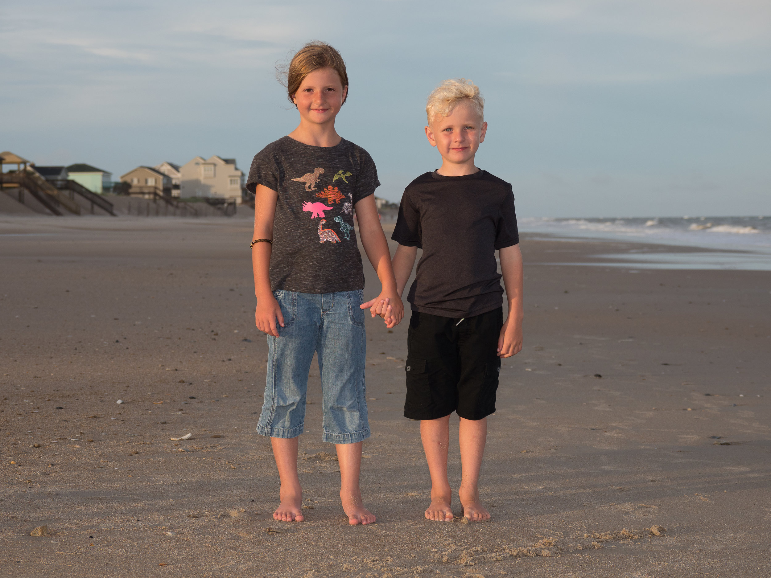 - Sometimes simple is best. Brother and sister holding hands on the beach. Topsail Island, NC.